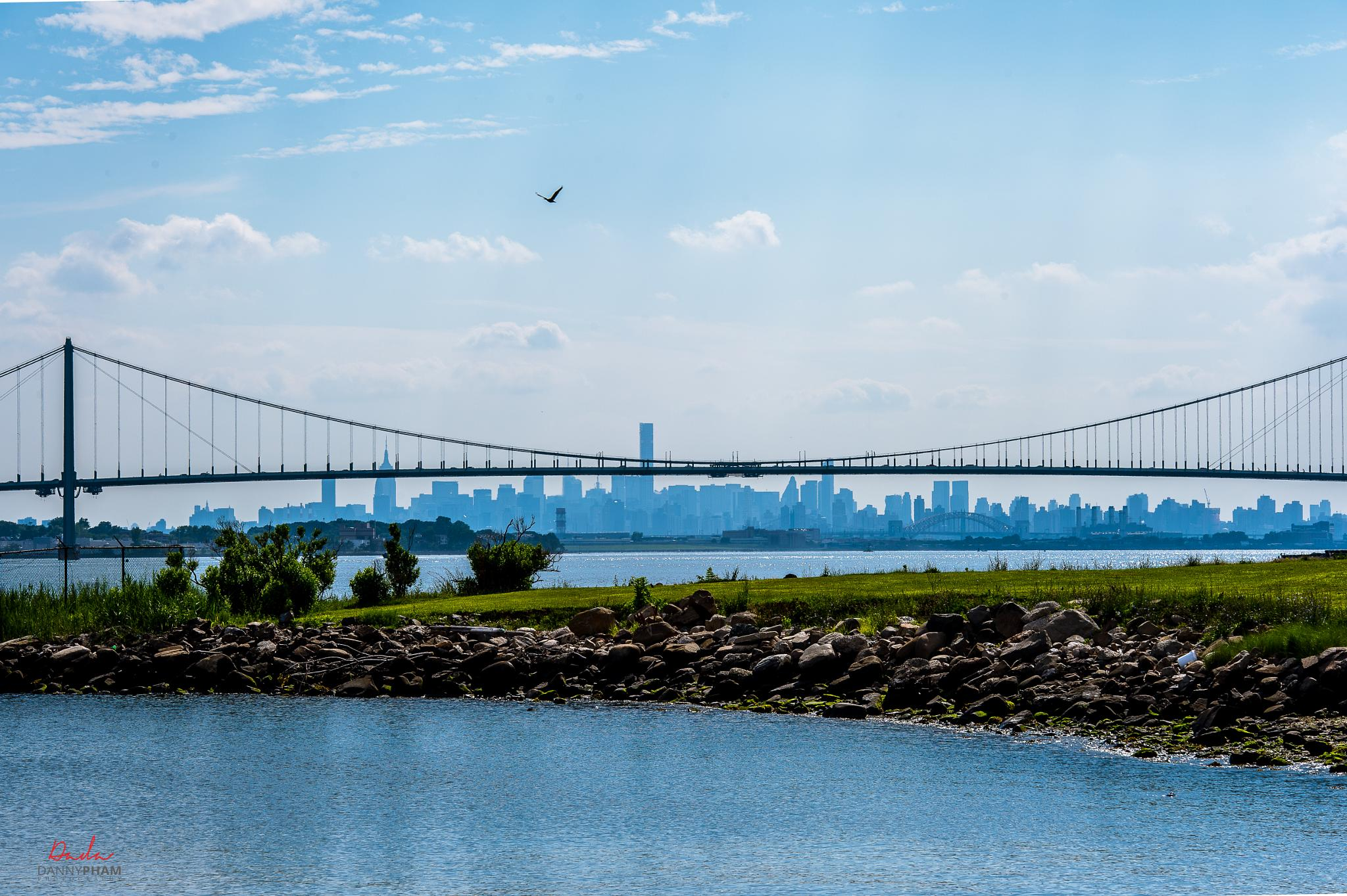 White Stone Bridge with New York City view from a distance by Danny Pham