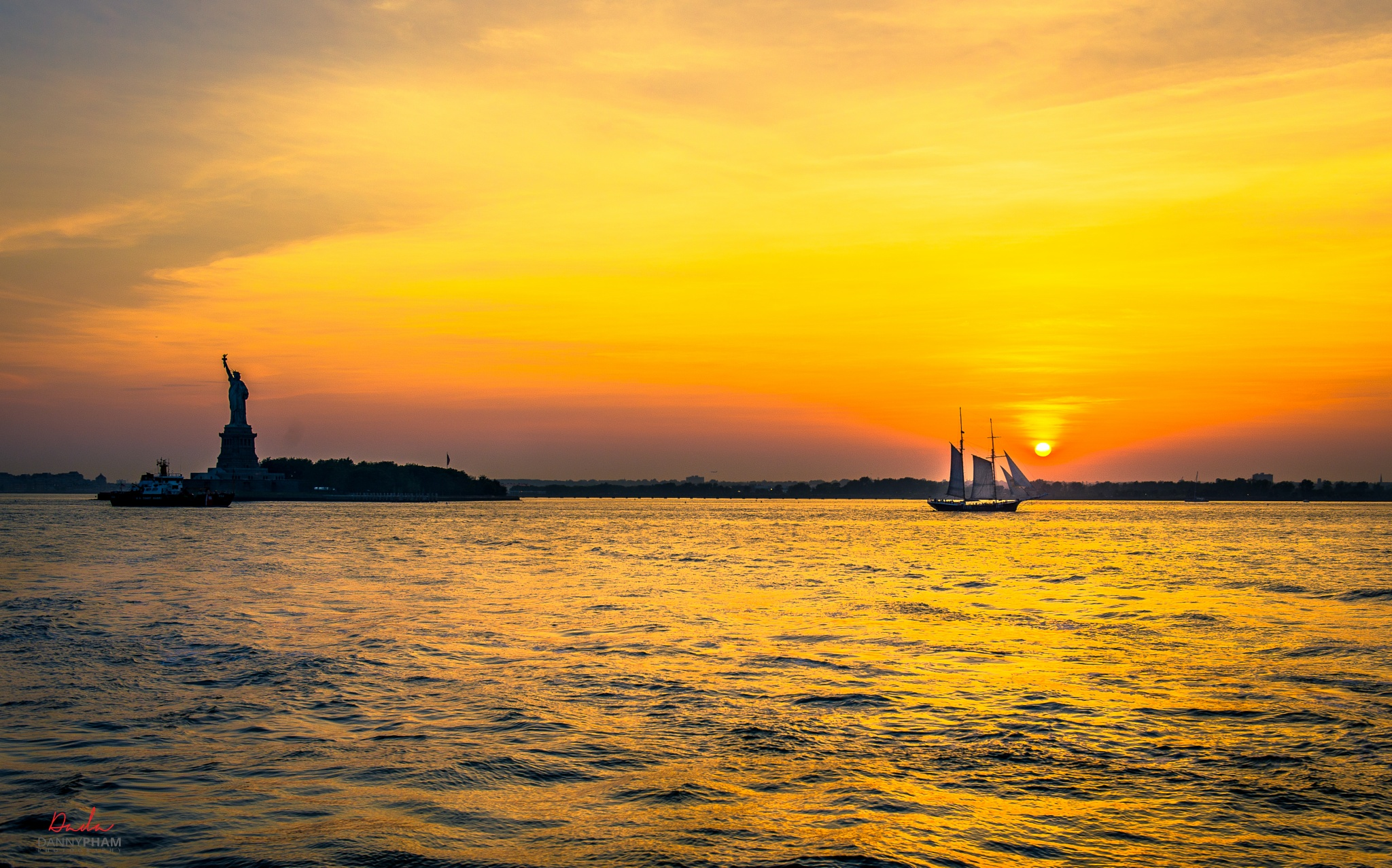Sailing under Sunset into The Lady Liberty! by Danny Pham