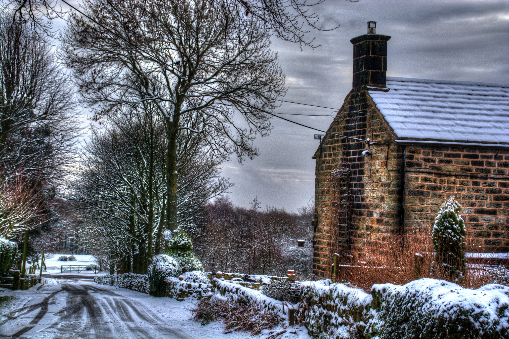 cottage on a snowy country lane nr worral by Stuart Robertshaw Photography