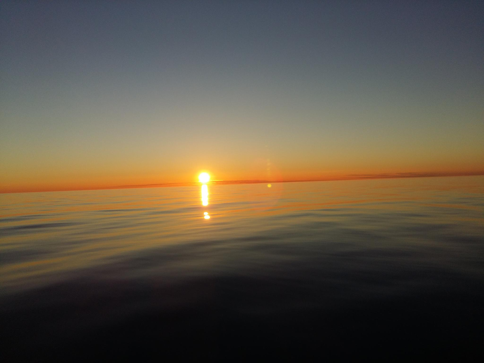 Sunseth at sea, North Norway by Tor Johansen