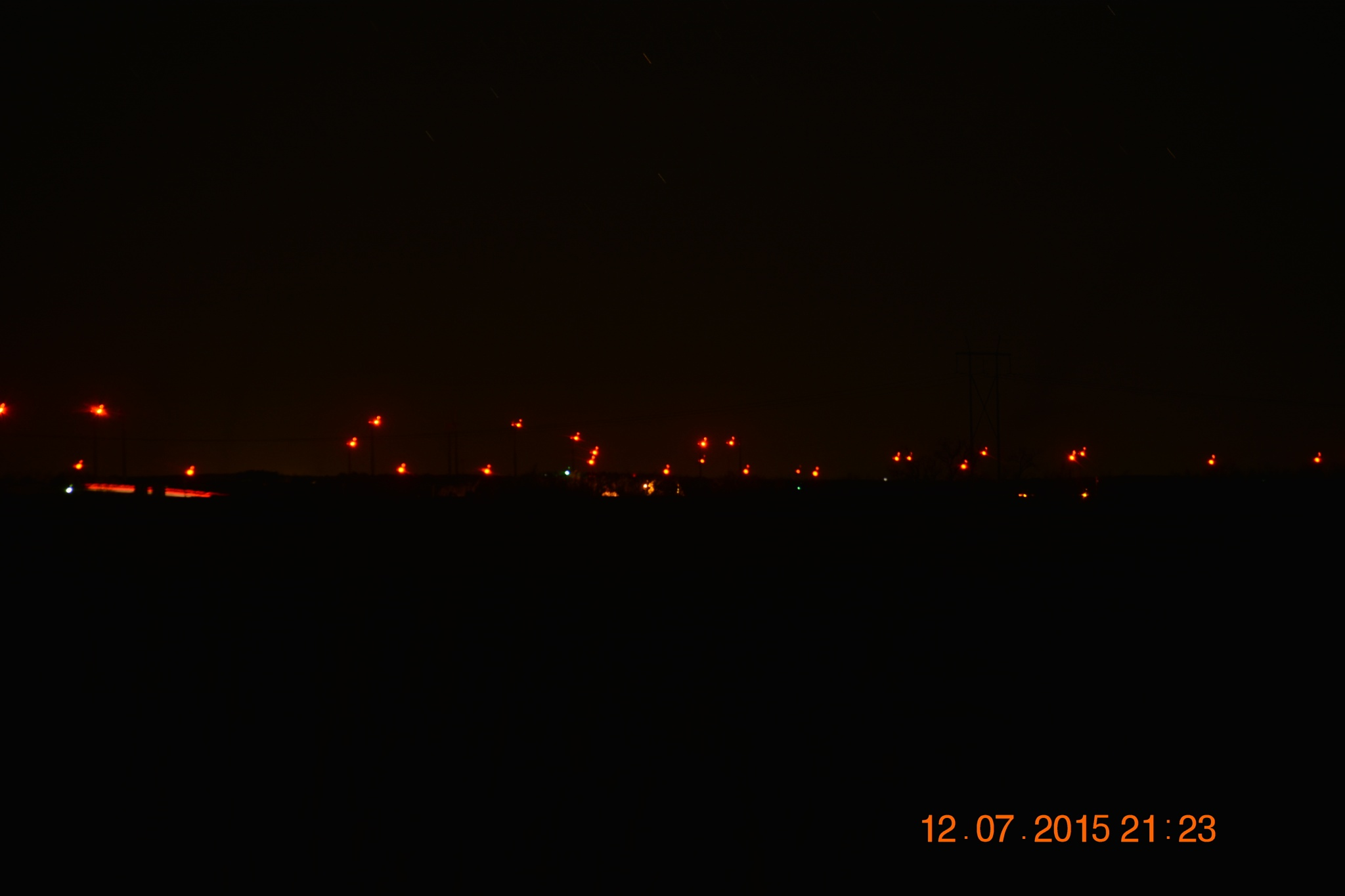 Wind Turbines in the Night by roughneck1-9