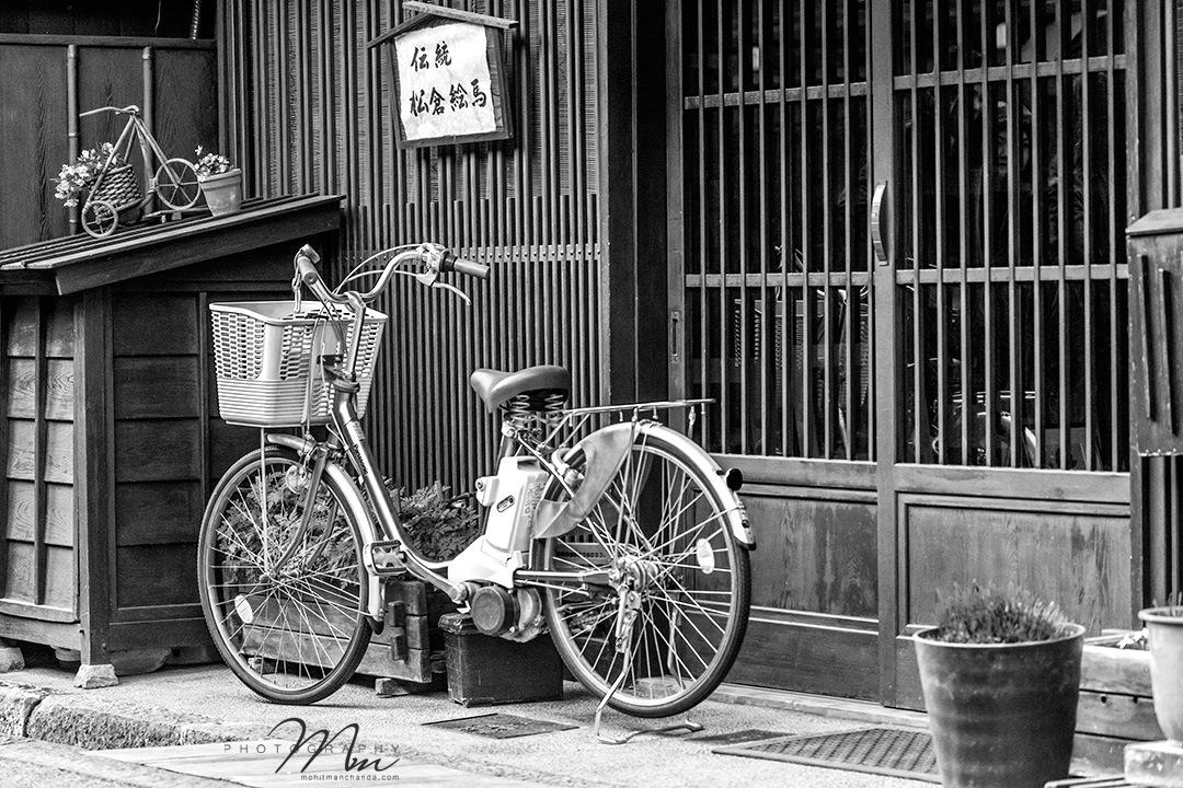 Sanmachi Suji District, Takayama Old Town, Japan.  #bike #bicycle #wheel #basket #gate #entrance #wo by Mohit Manchanda Photography