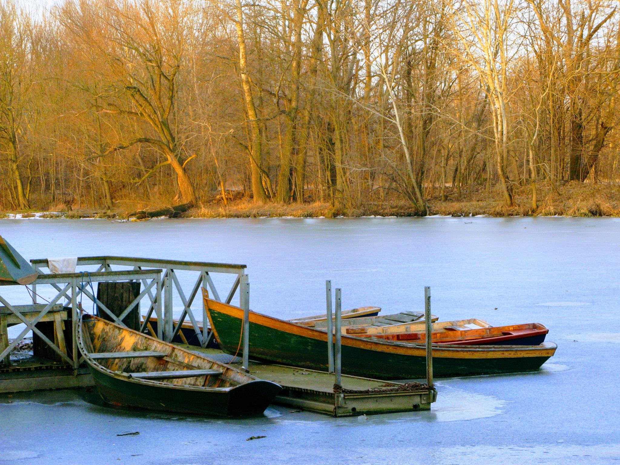 Boats on the frozen lake by Ela Gajowska
