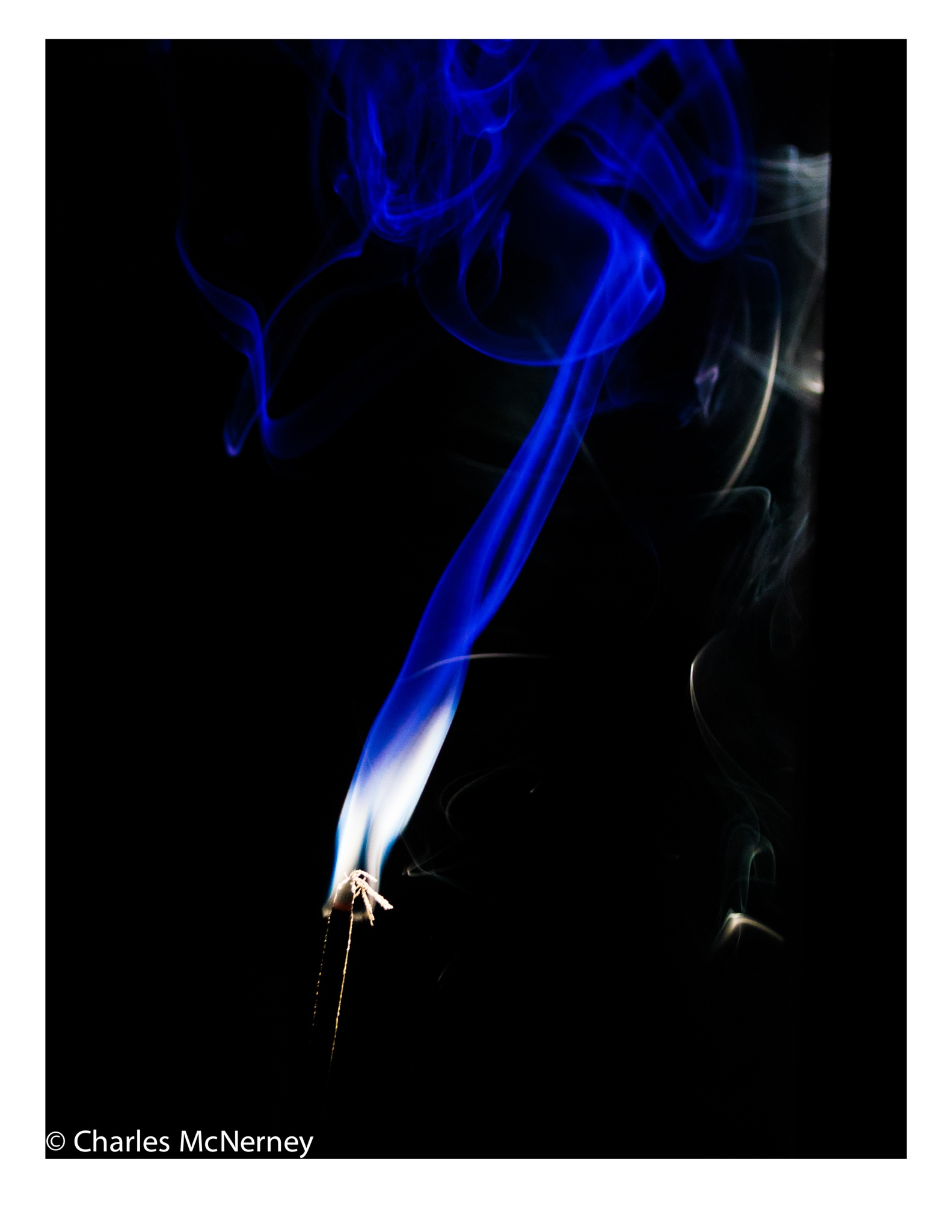 Incense in the blue light by Charles D McNerney