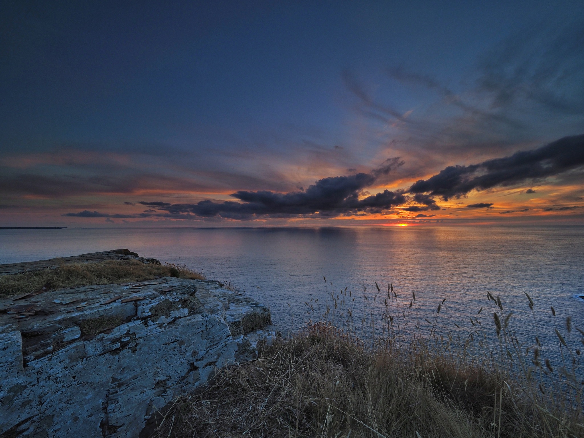 Sunset off the coast of Cornwall by Derek Thompson