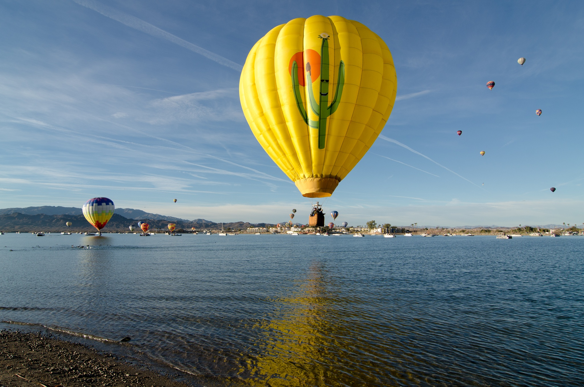 Yellow Balloon on Lake by Jeff Jones