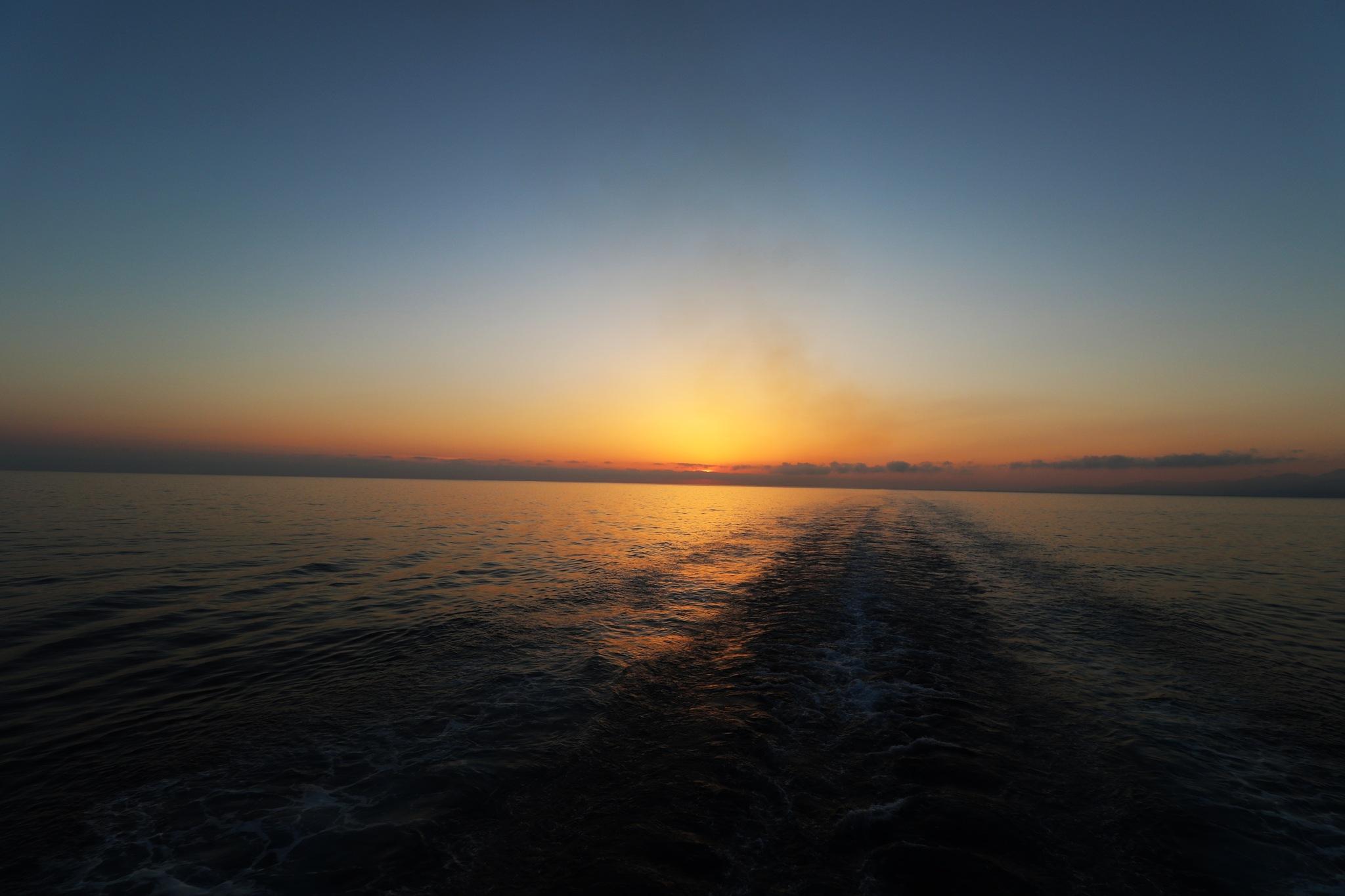 Sunrise above the sea by ITZIK YOTVAT