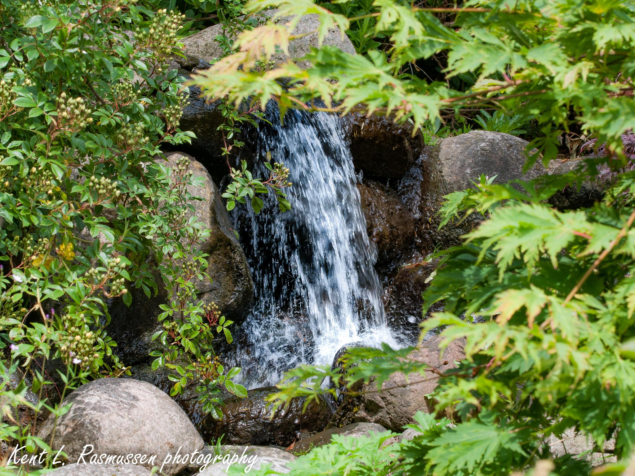 Small waterfall by Kent L. Rasmussen