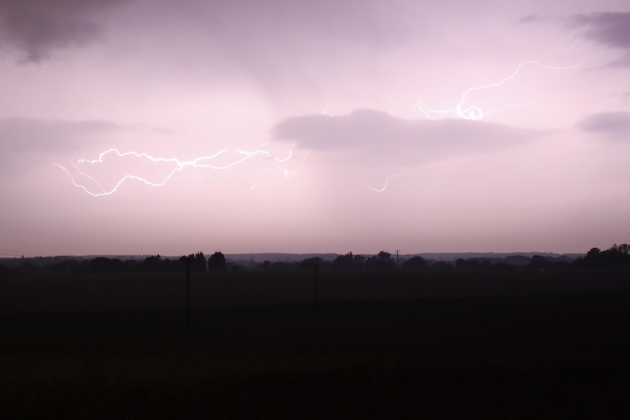 Lightening over the fields by Russell Waite