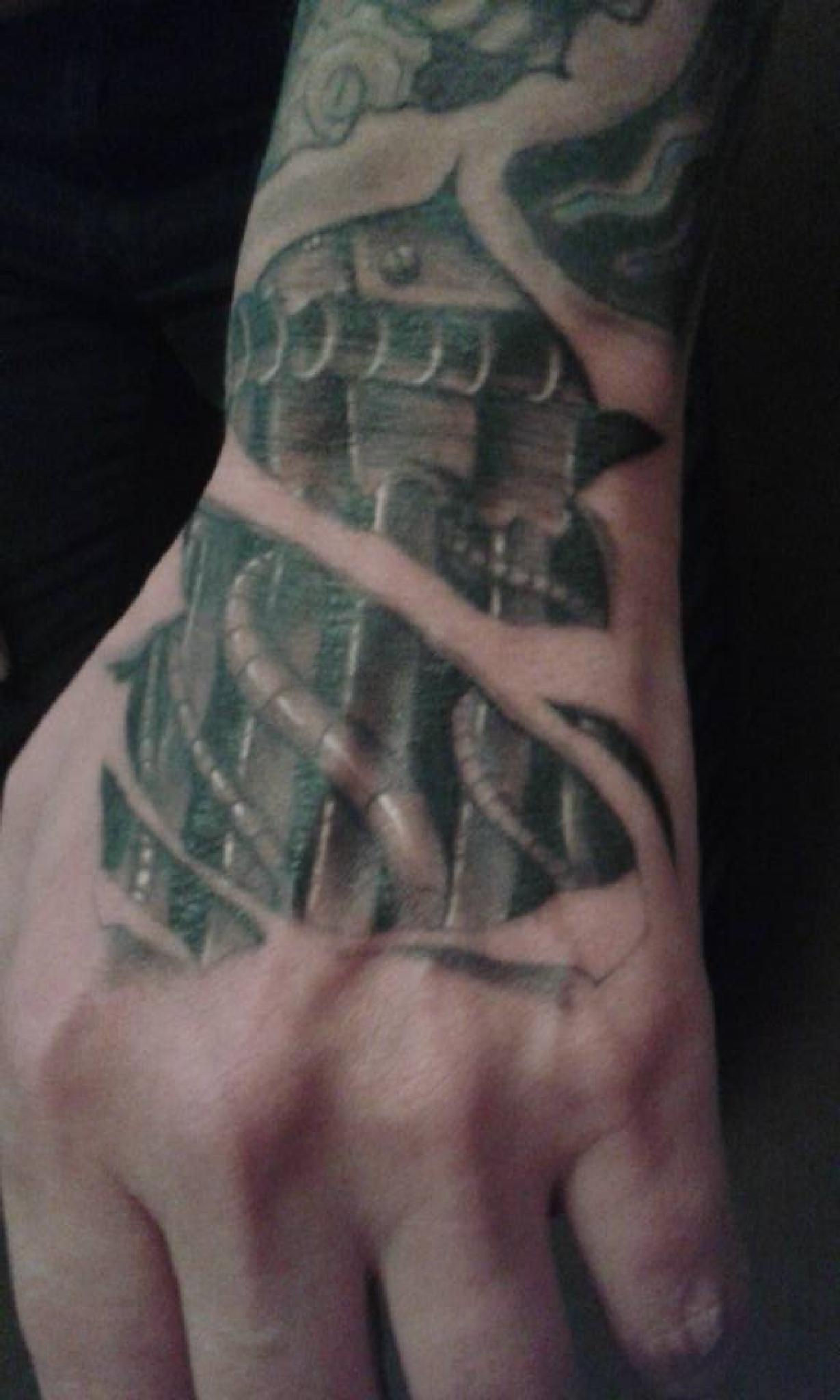 my bio mech hand tattoo by tatdaz2