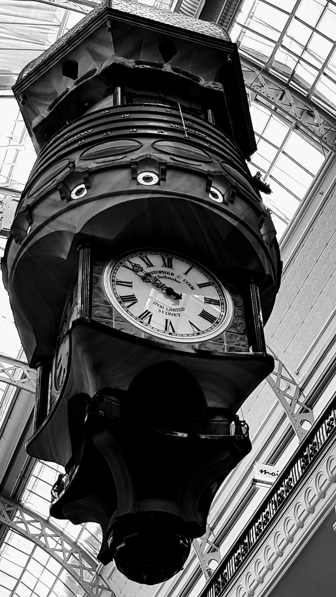 Large hanging clock. by Michael De St Pern