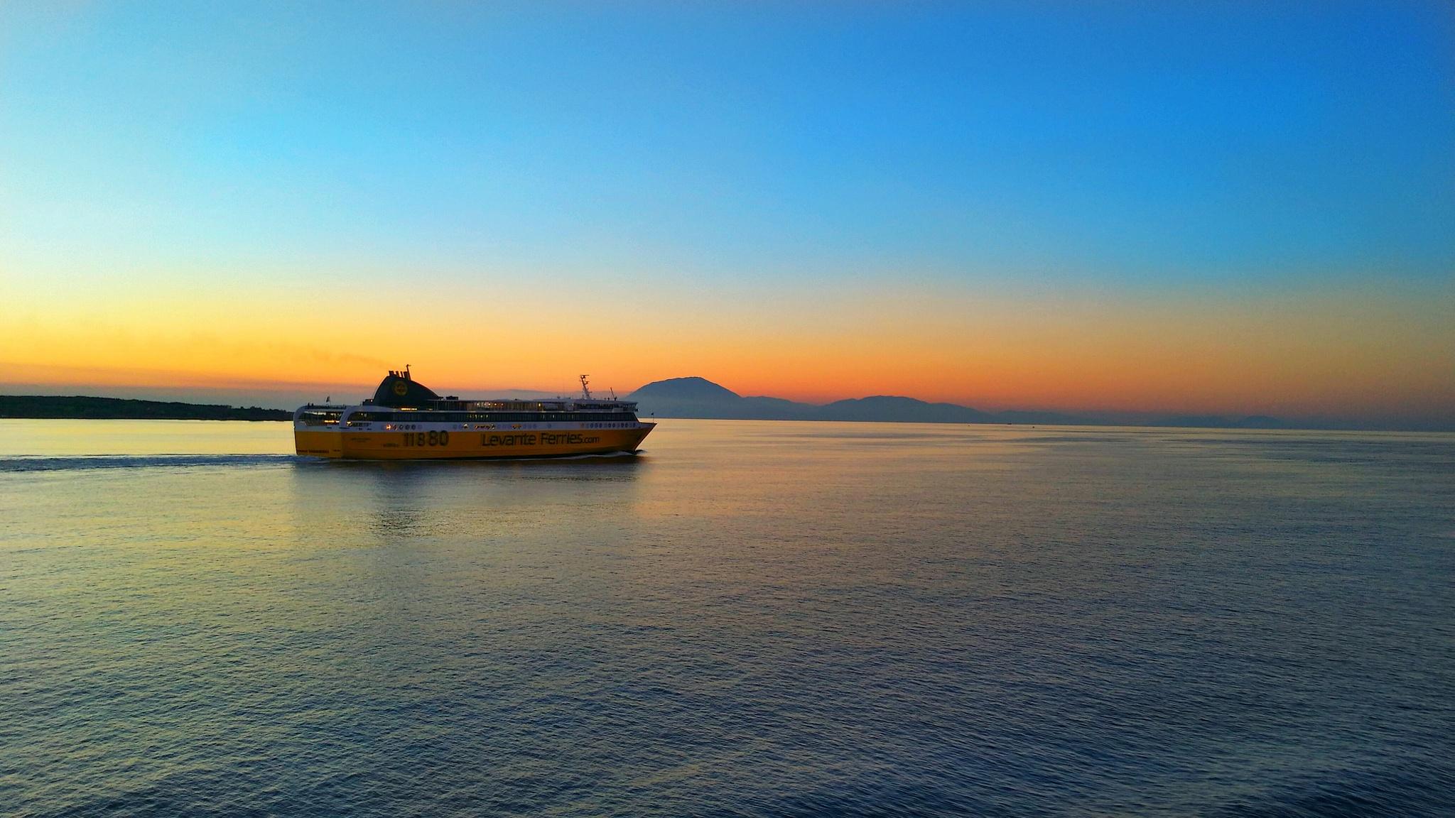 Ferry boat in sunset  by vasilis fragiskatos