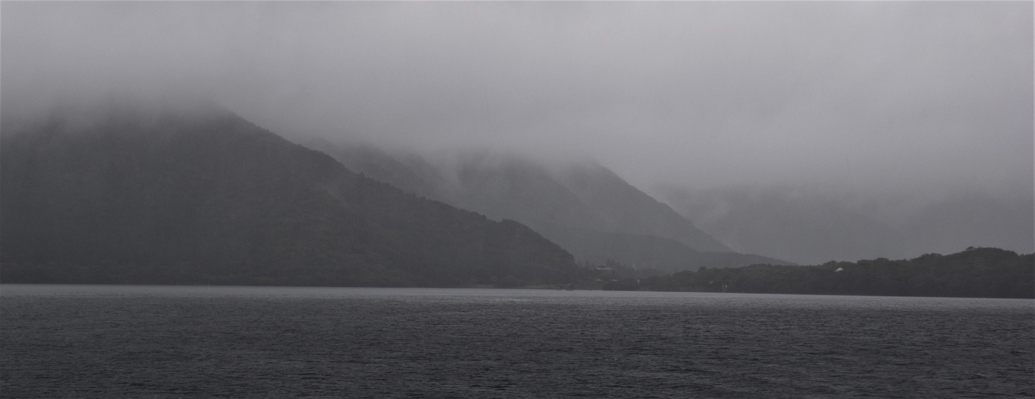 Lake Ashi on Rainy cloudy windy day. Kanagawa Prefecture by Kishore Shetty