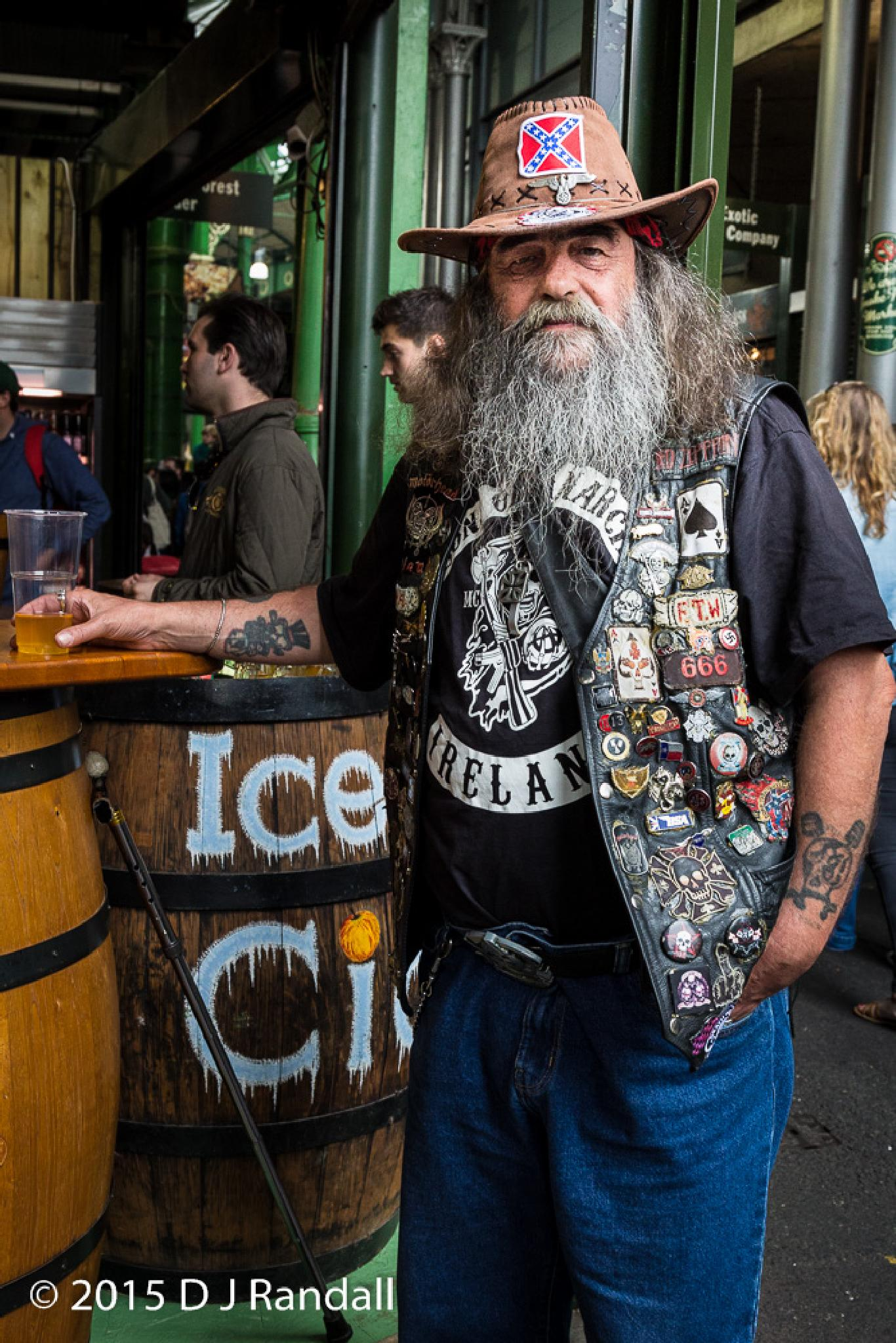 Drinker at a bar on the edge of London's Borough Market by Albatroff