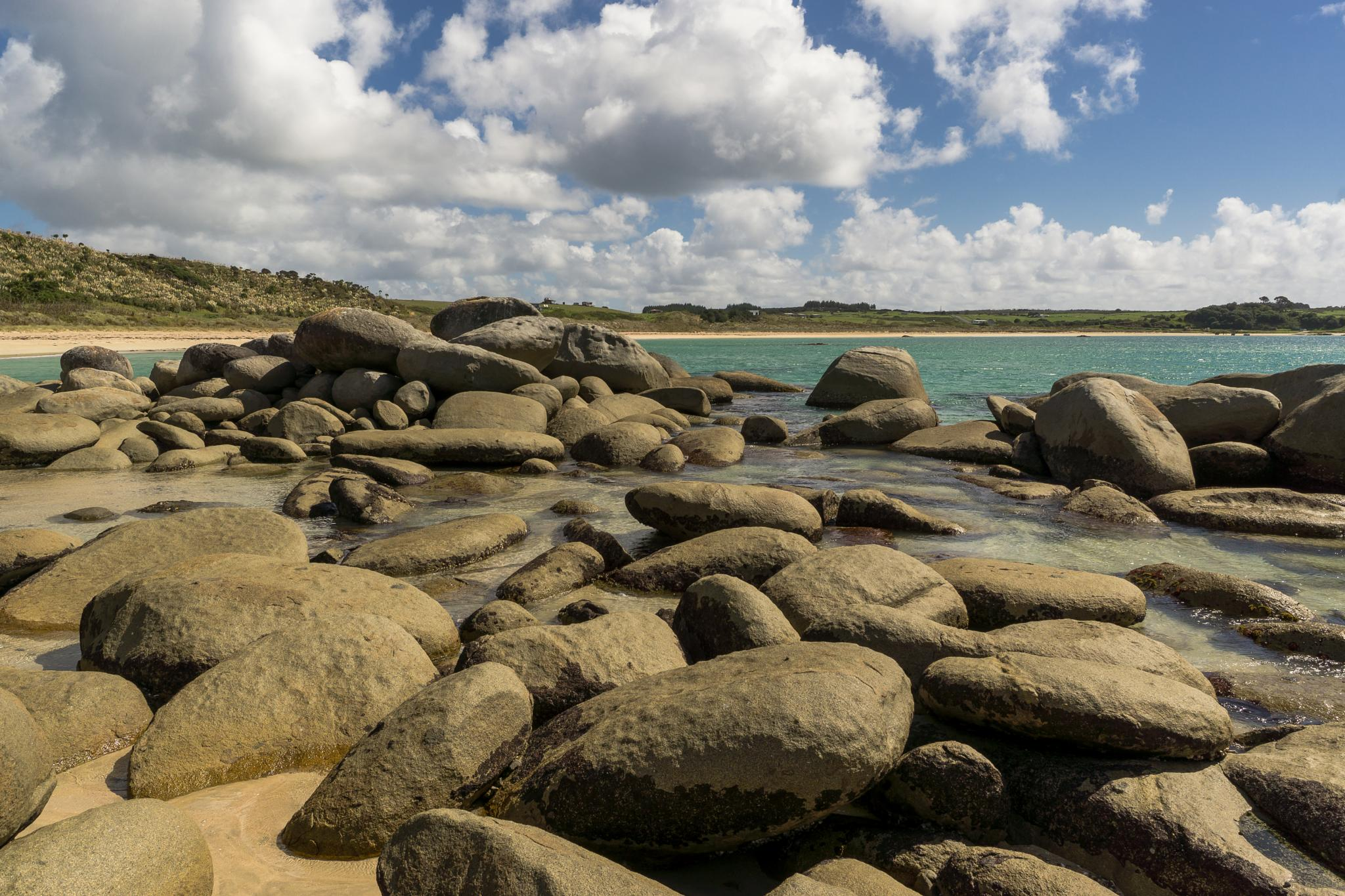 Stones on the shoreline of Matai Bay, Northland NZ by Jackie Evans