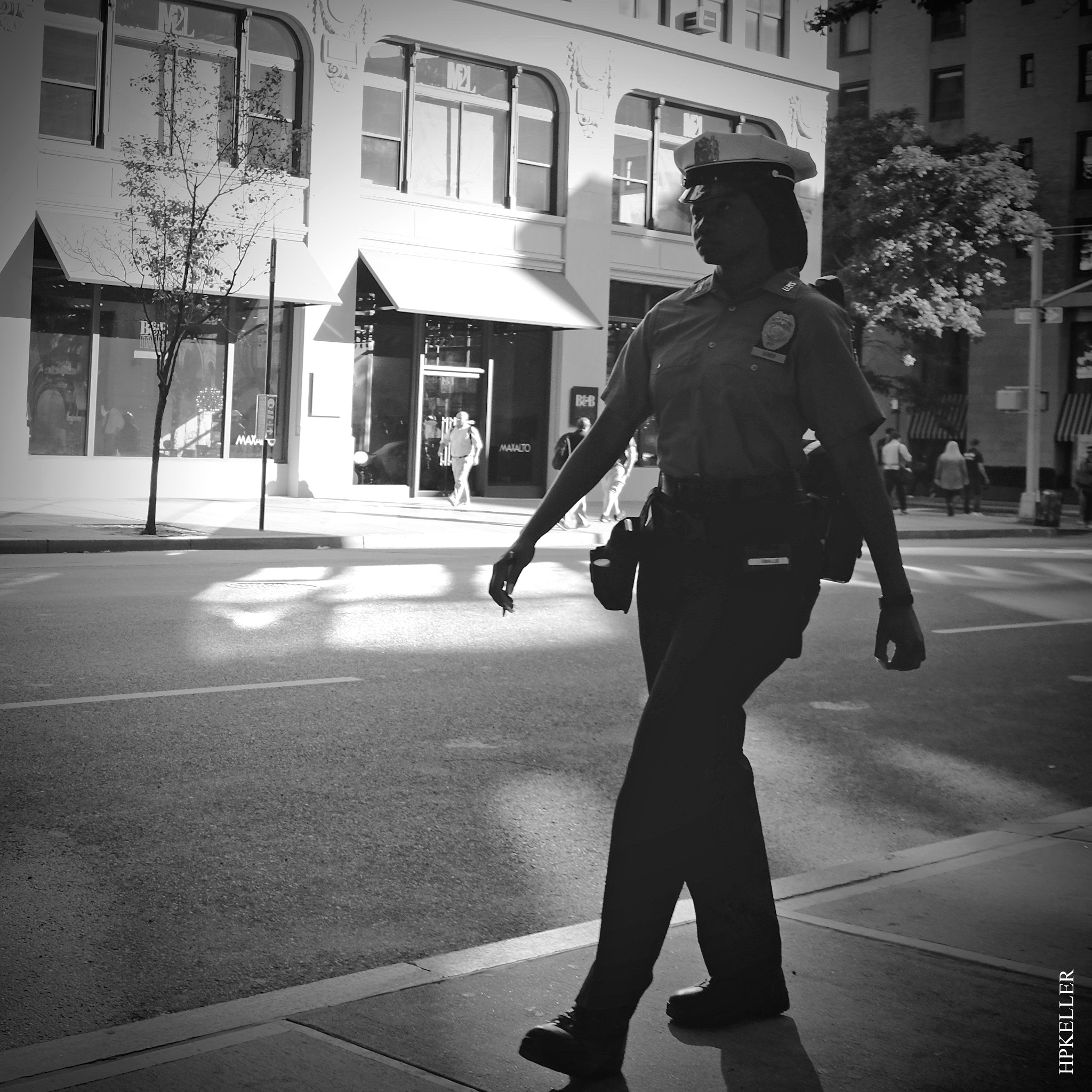 Some days ago in NYC, ...beautiful officer on the catwalk. by Hans-Peter Keller
