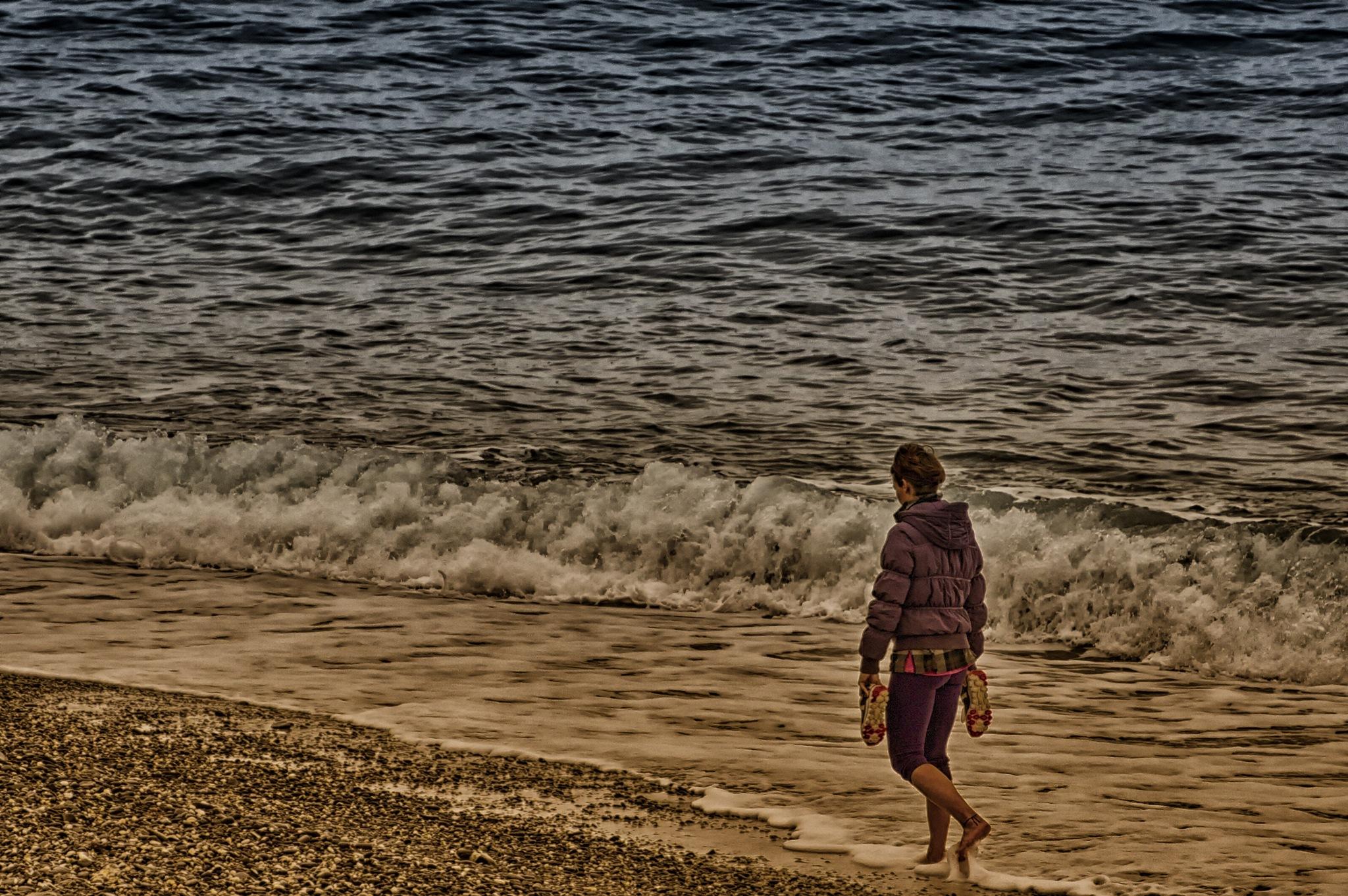 strolling on the sea shore by sunrisesunset