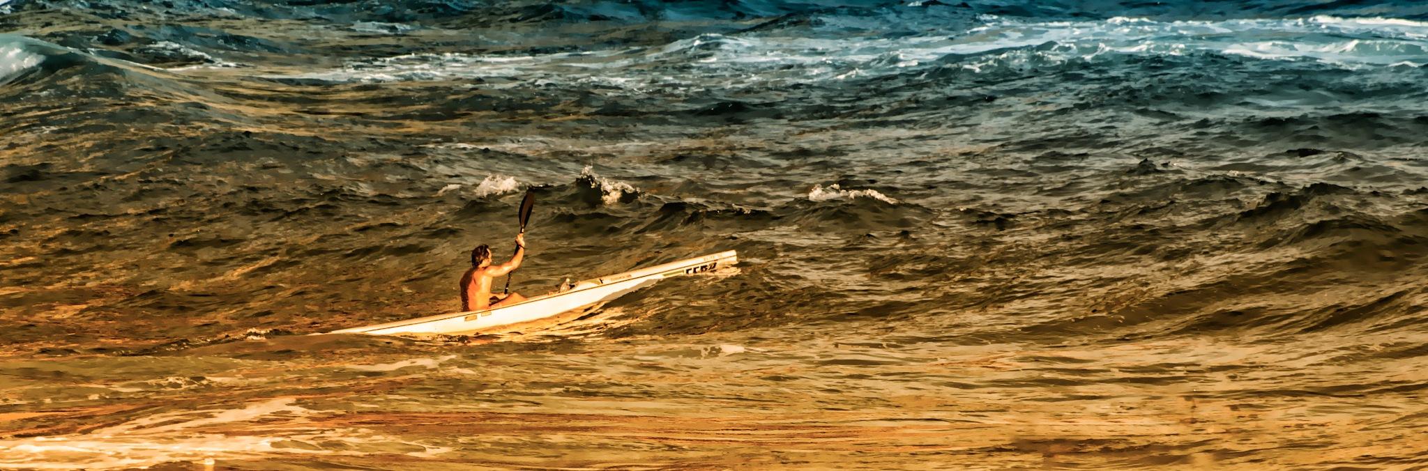 canoe in the seastorm by sunrisesunset