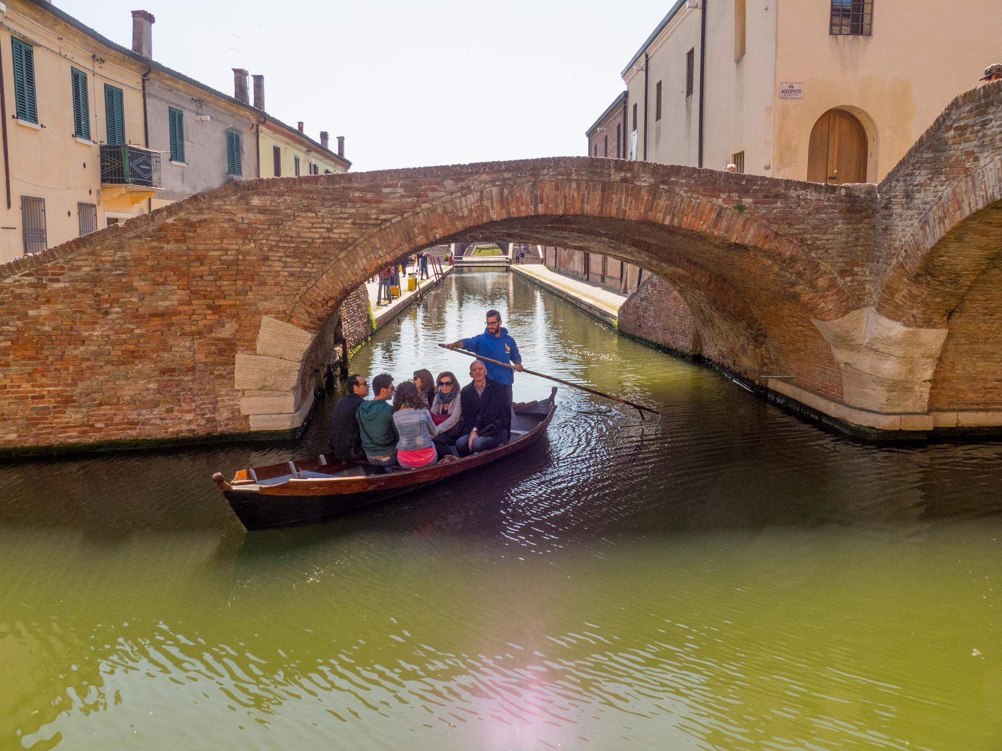 under the Comacchio bridges by sunrisesunset
