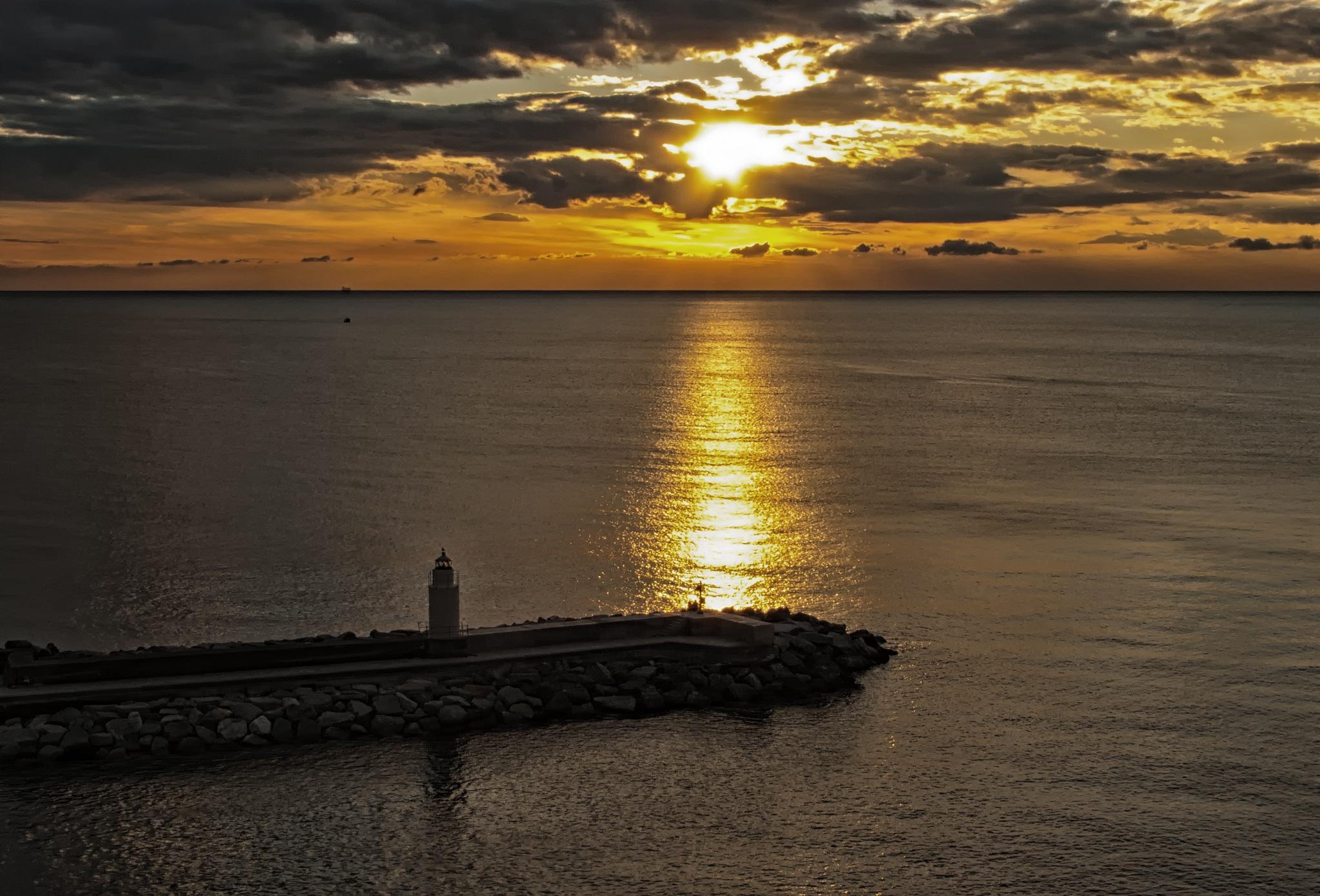 sunset on the lighthouse by sunrisesunset
