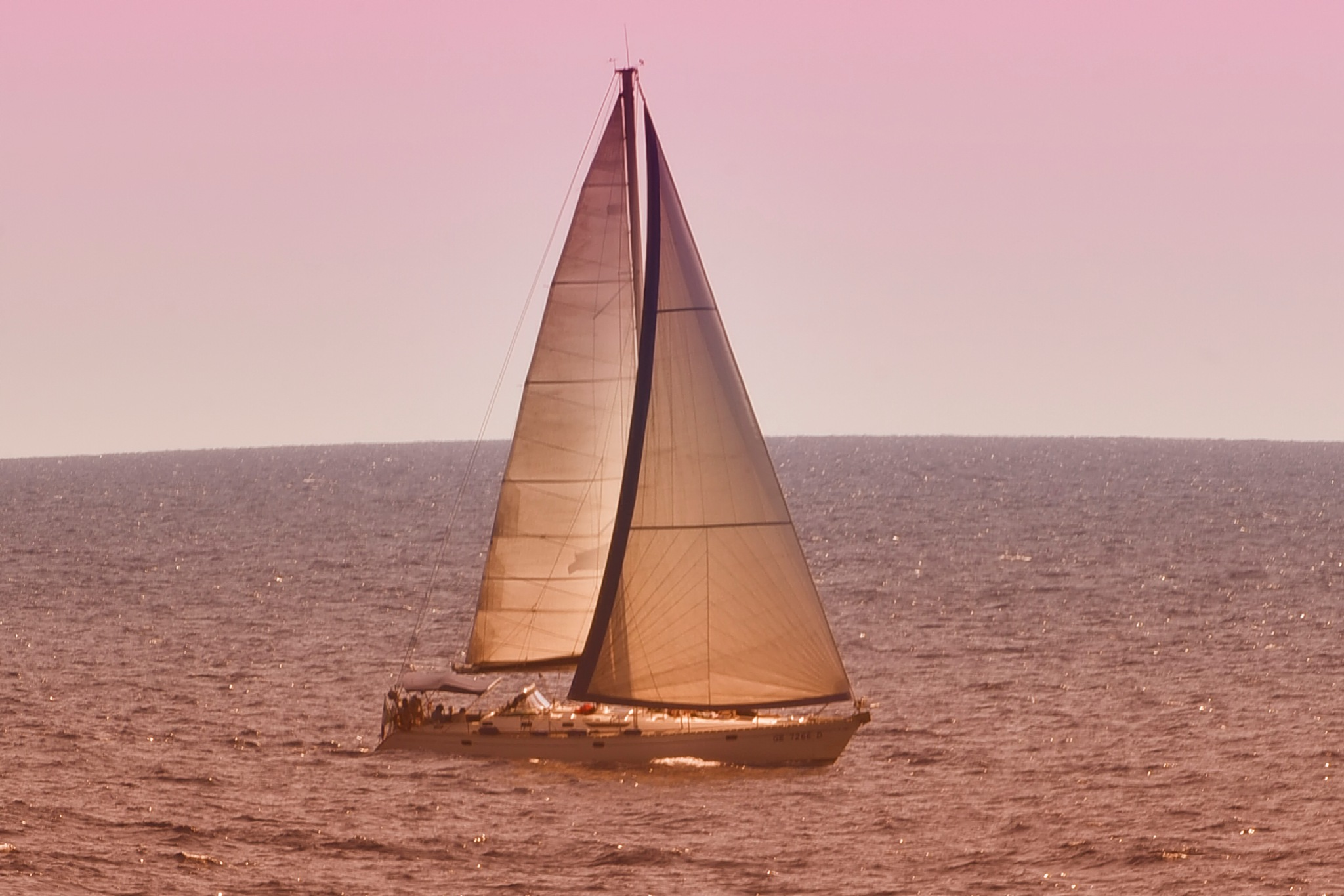 sail in sea by sunrisesunset