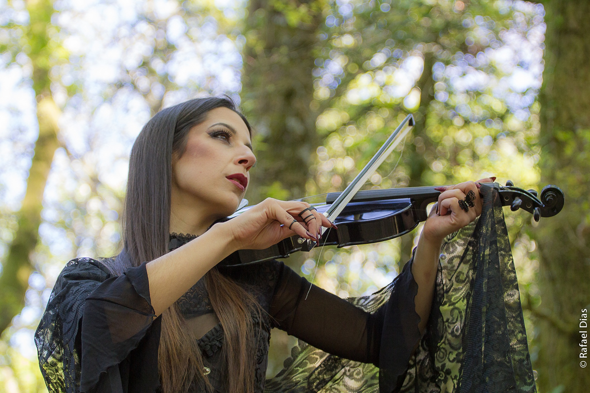 Playing the Violin by Rafael Dias