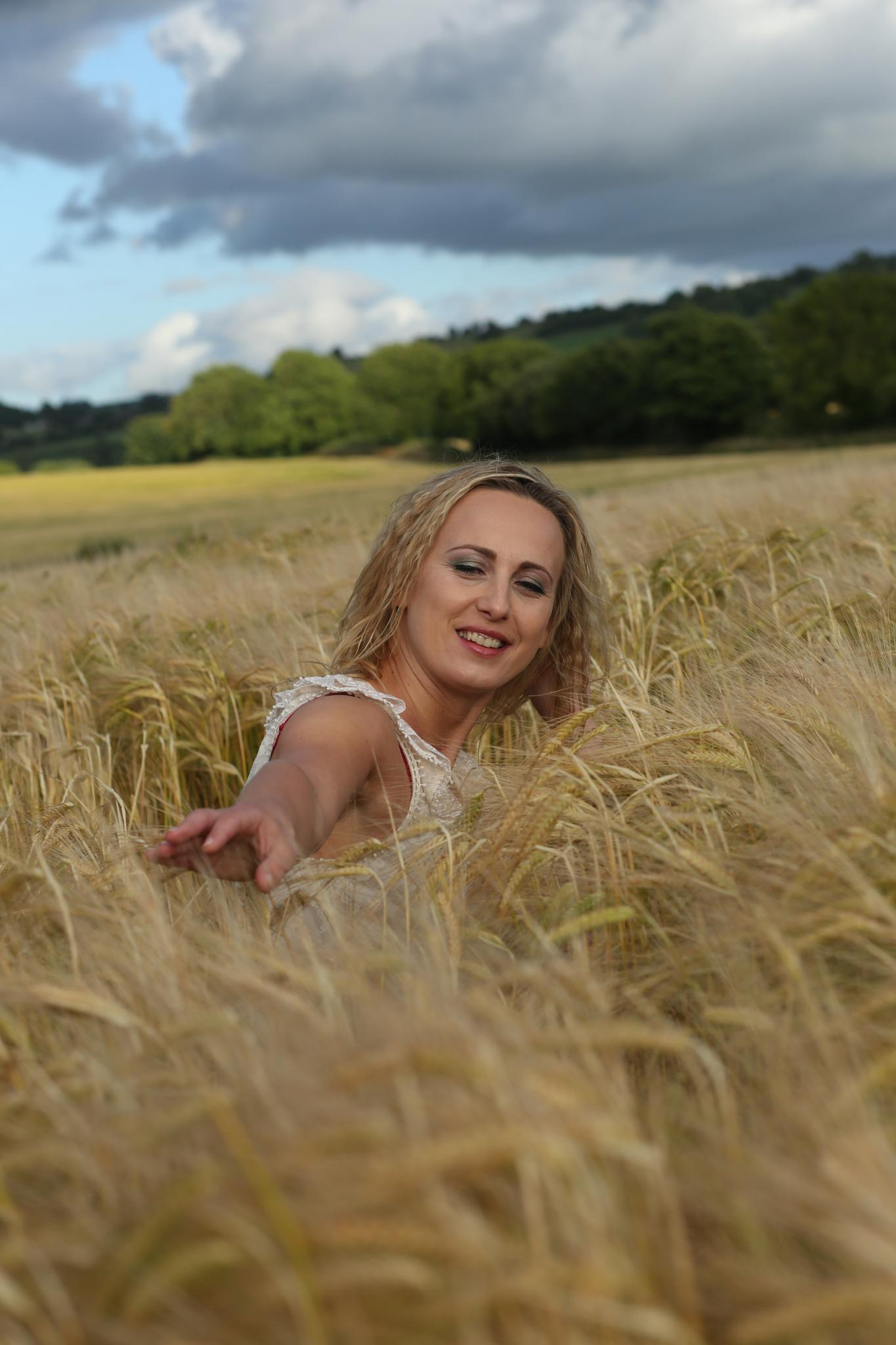 Playing in the summer fields by johndsull