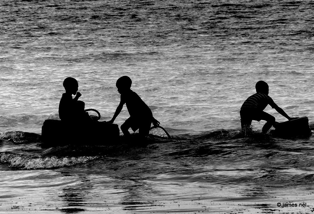 boys having fun in the water ... by James Nel