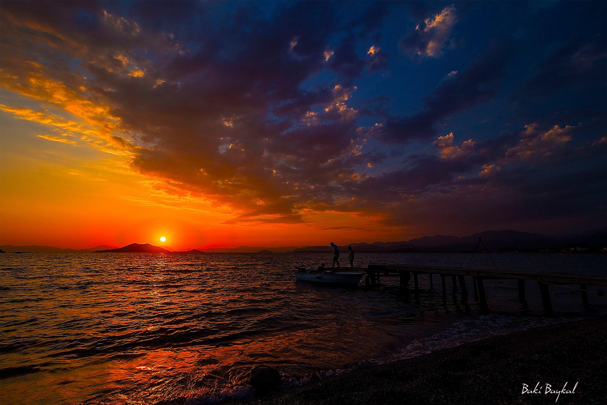 Enjoying the sunset on the Calıs beach by Baki Baykal