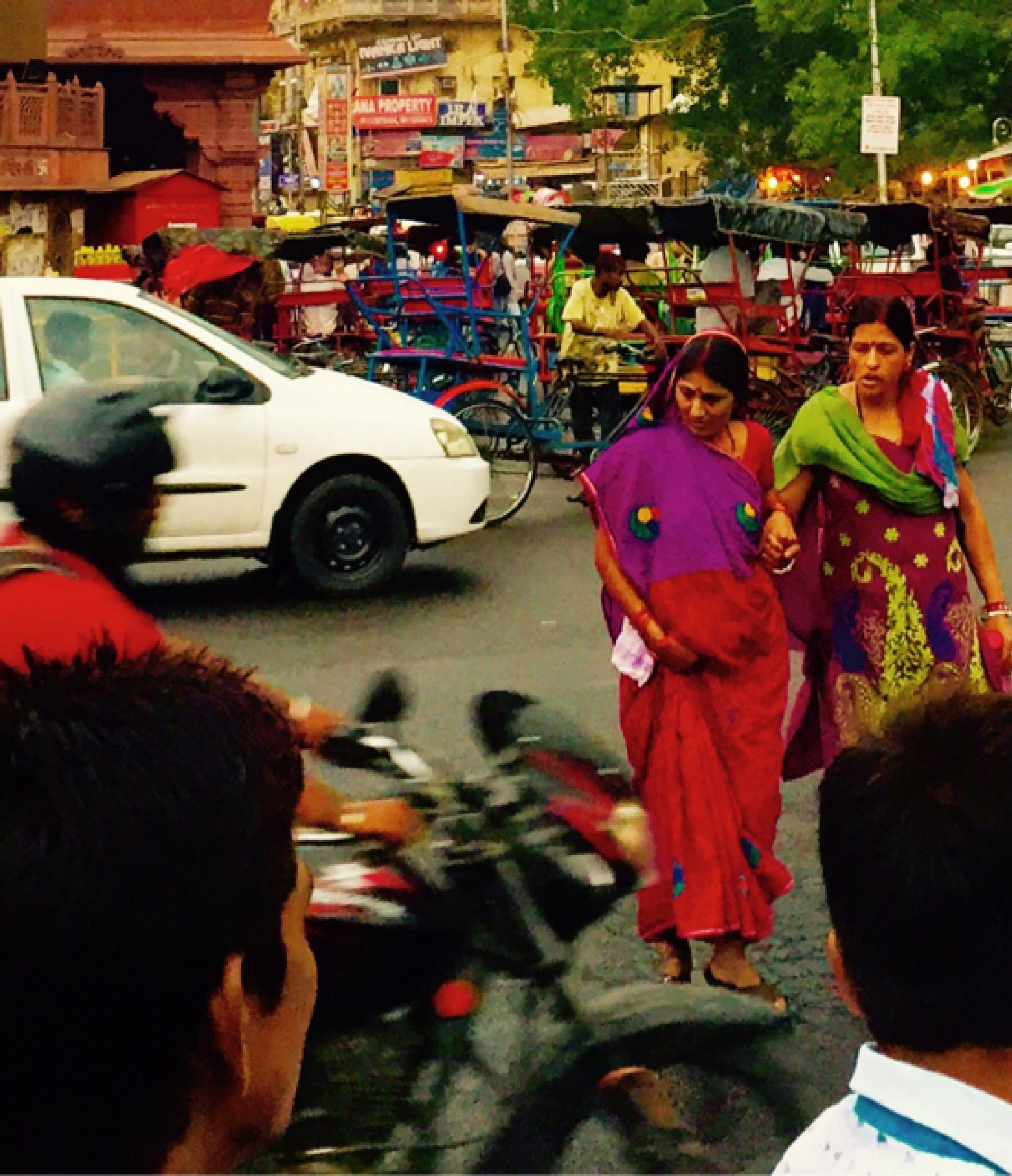 Women surviving in Indian traffic by henningwaschk