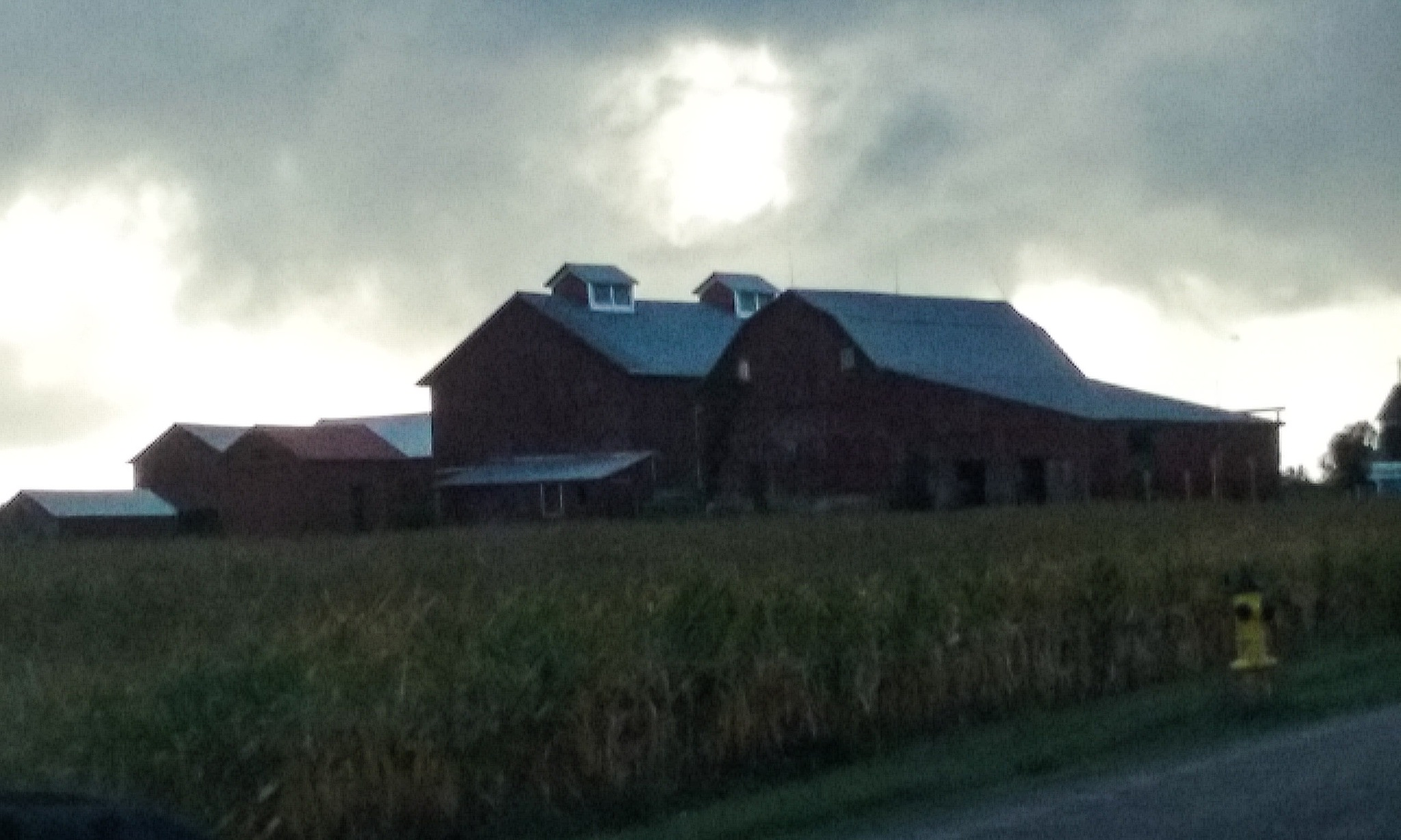 Rain Clouds Over Barns by Mark Morrison-LeMay