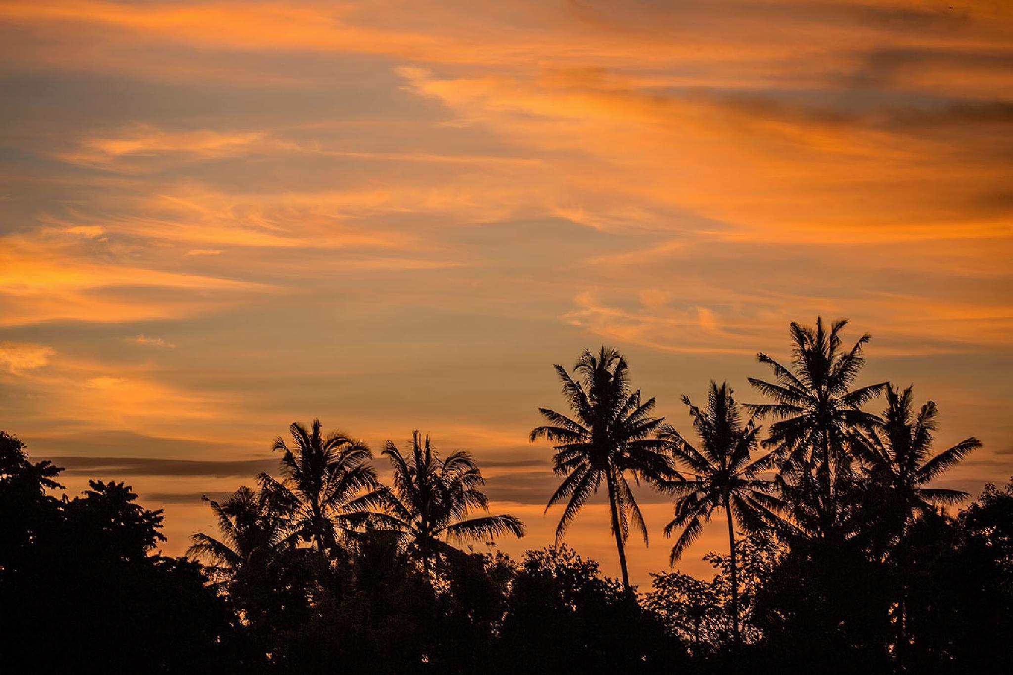 Sunset in Bali creating an orange sky by harshsekhsaria