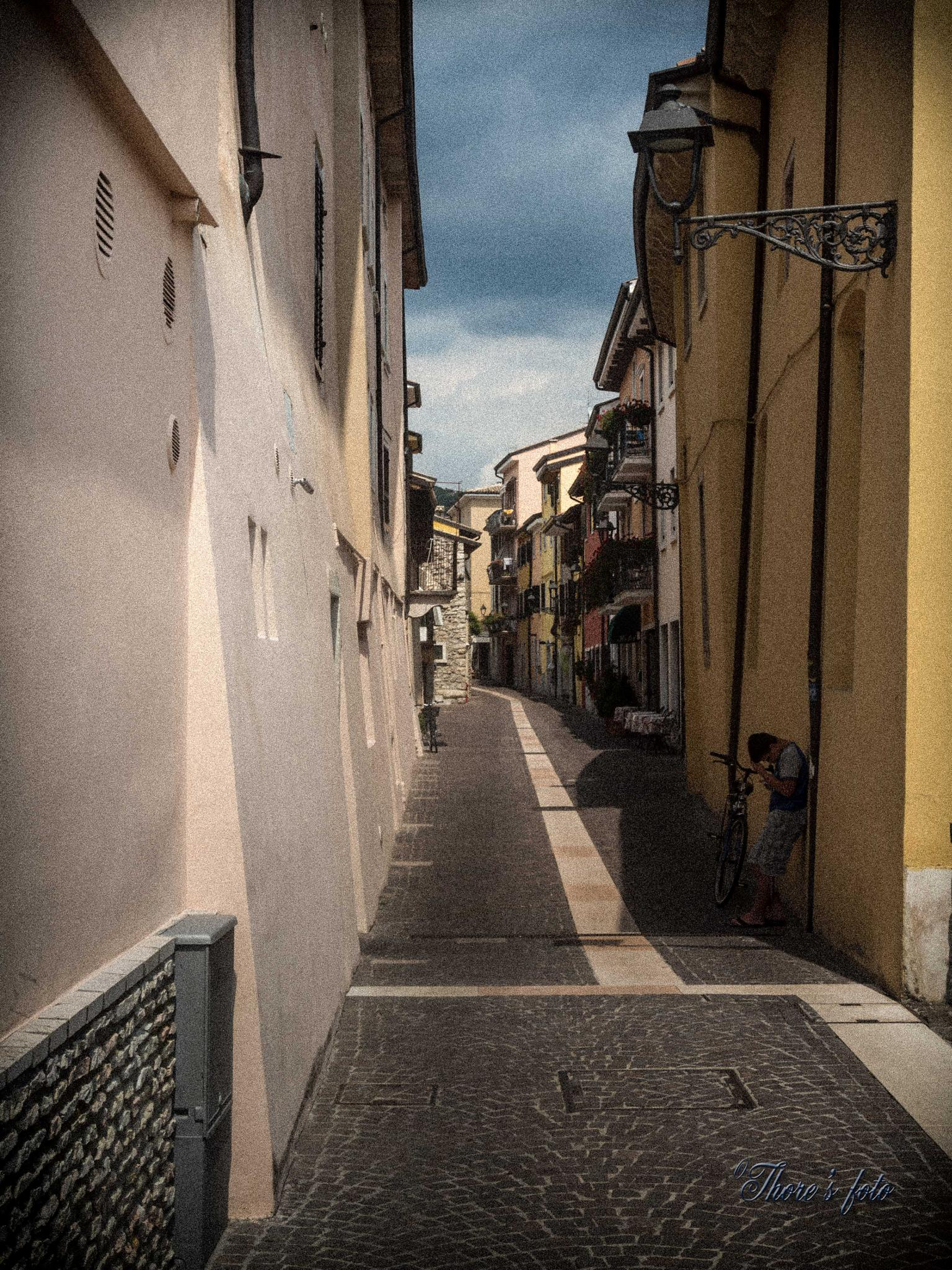 The empty street and a sad boy by Thore's photo