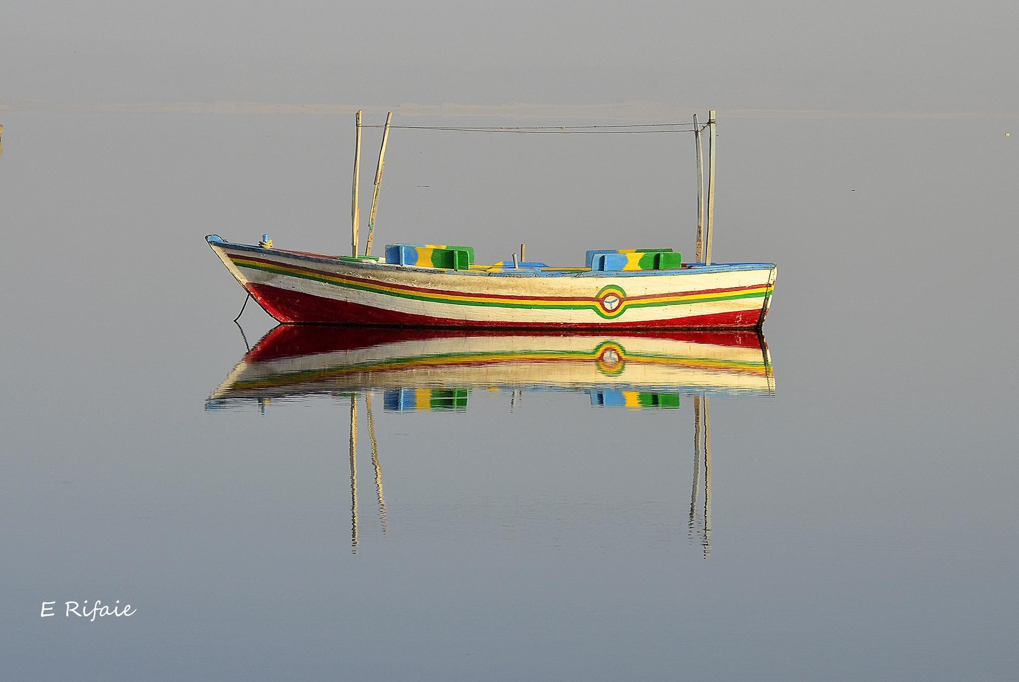 Boat reflection by Emad Eldin Moustafa El Refaie