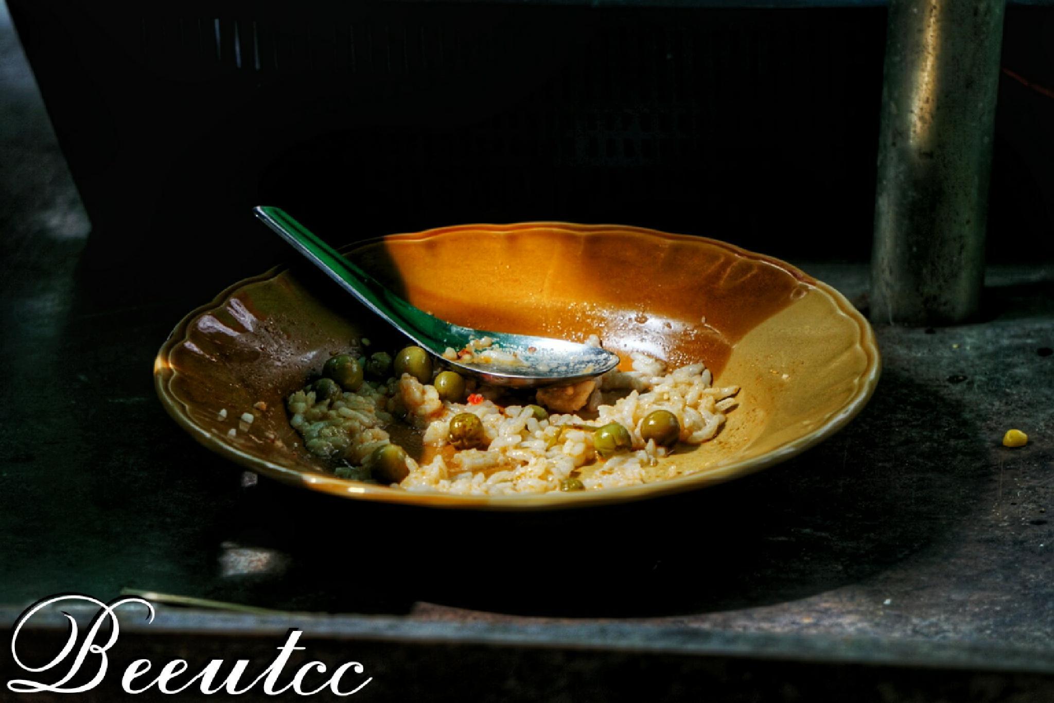 Half eaten meal by Natthawut Meesri