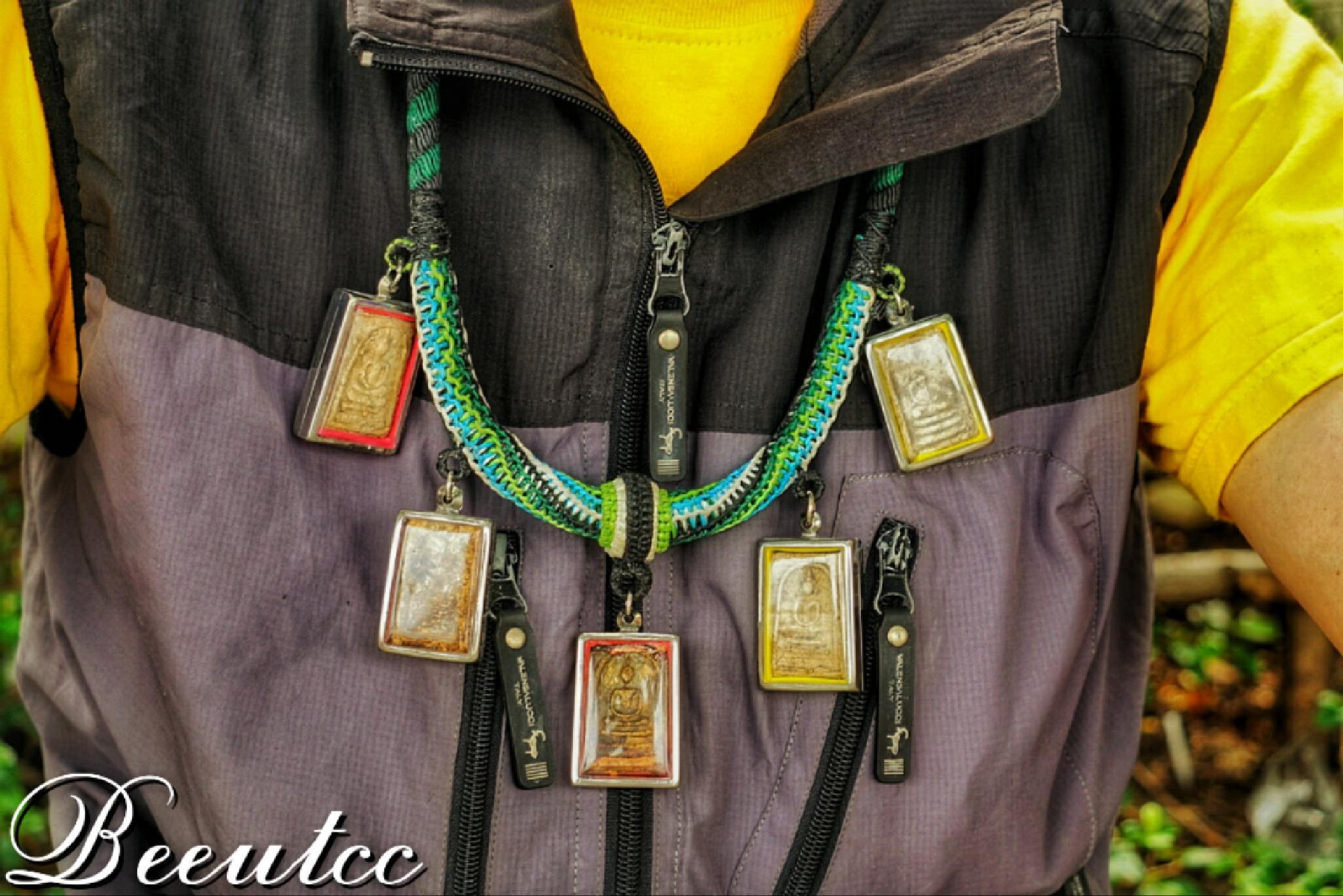 Amulets on the neck by Natthawut Meesri