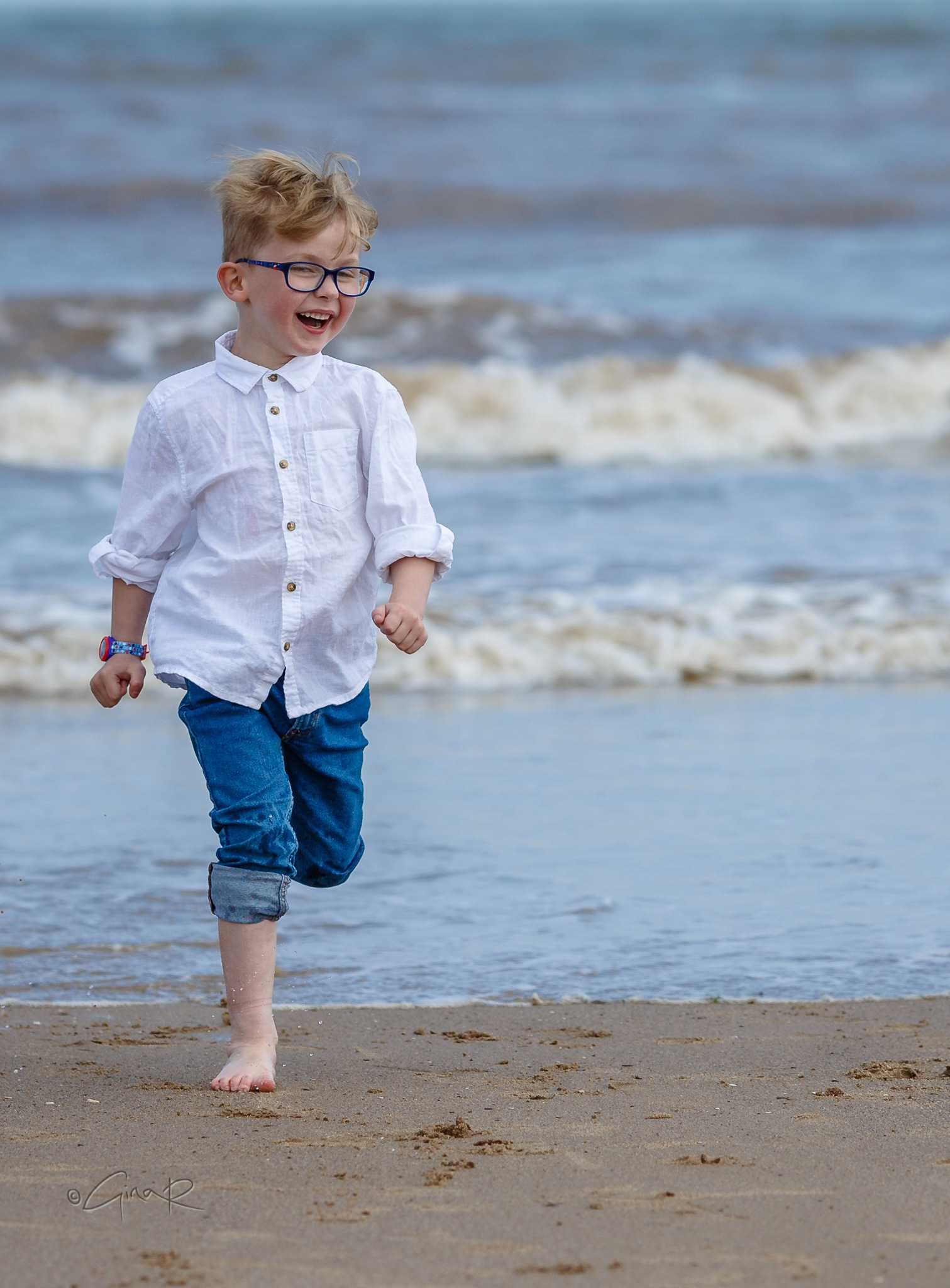 Grandsons having fun on the beach  by Gina Rayment