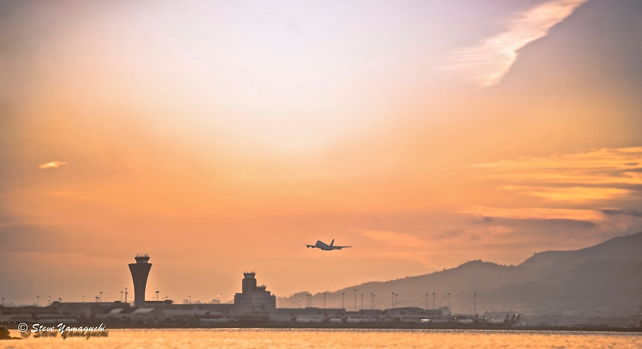 Early morning departures in between the fog by yamaguchisteve3