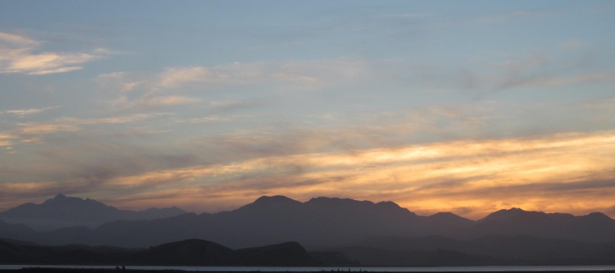 Day's last light softens the mountain ranges by johndflatt