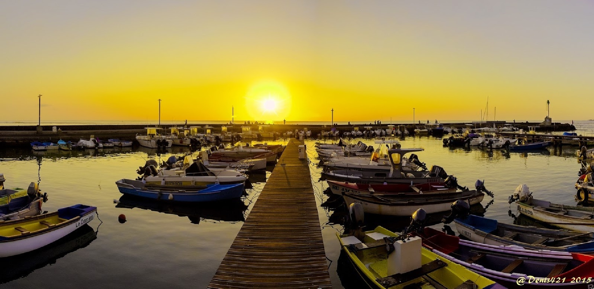 Marina and sunset by Denis Payet
