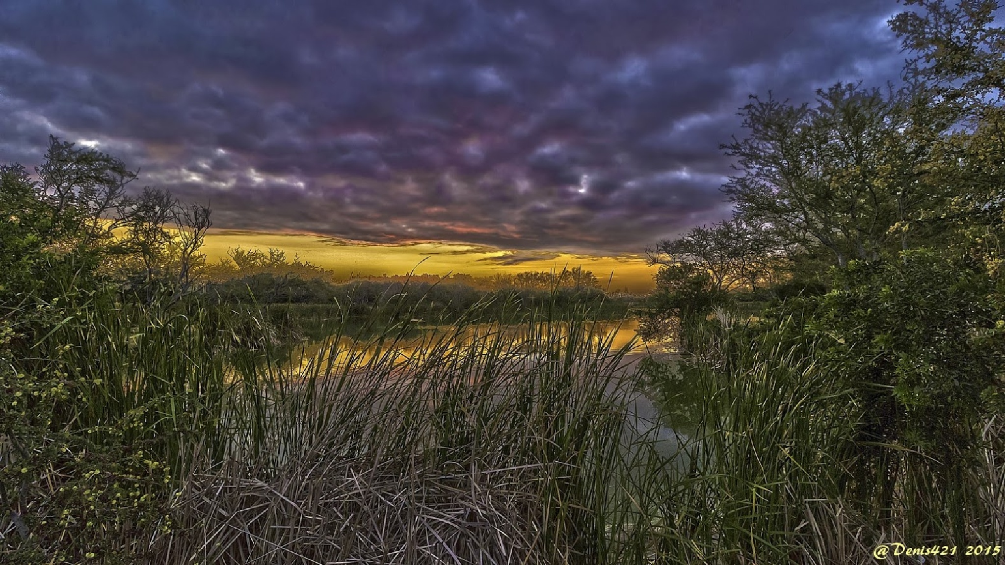 Sunset in cloudy day by Denis Payet