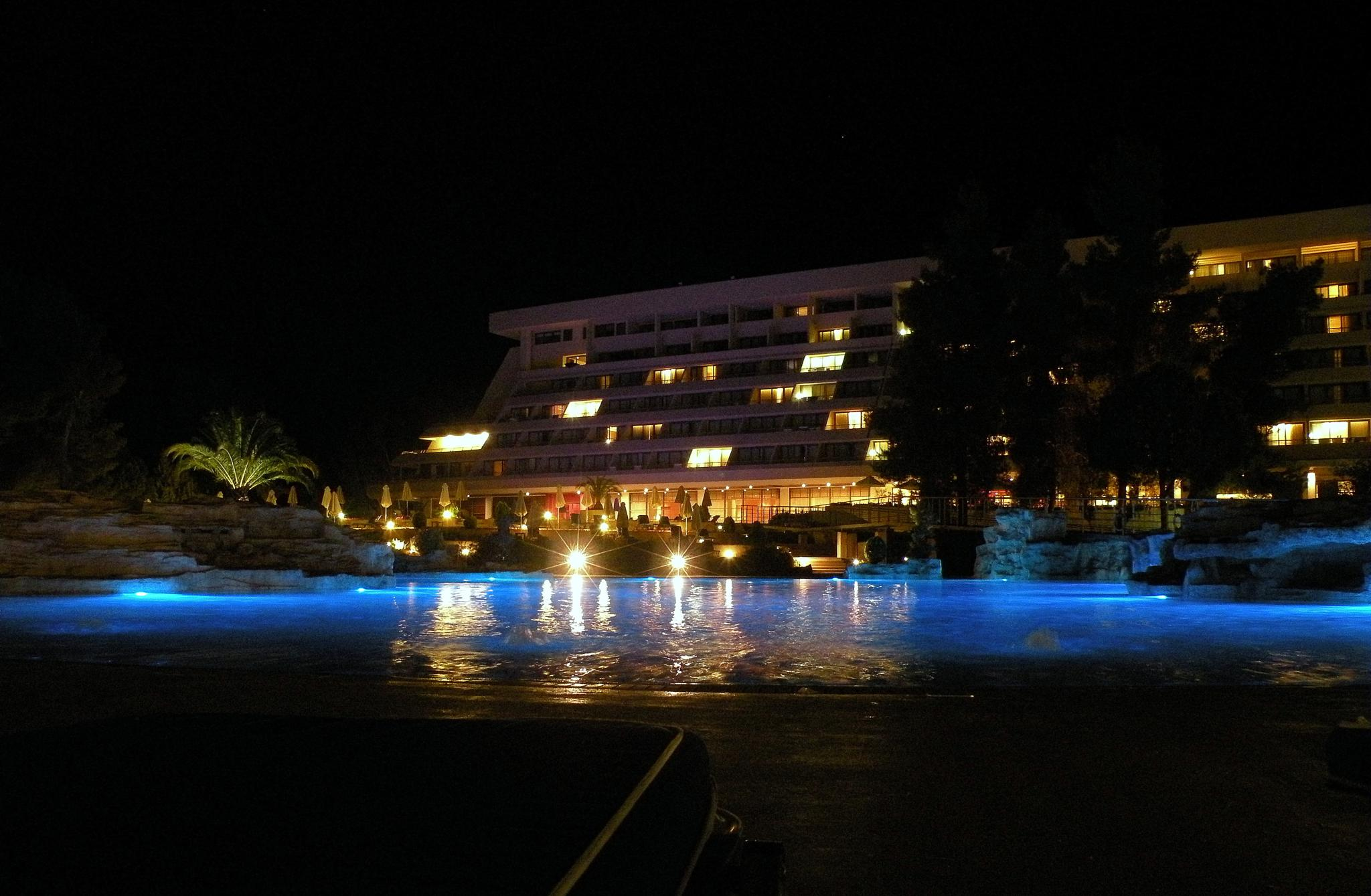 Pool and hotel by night by Costin0509
