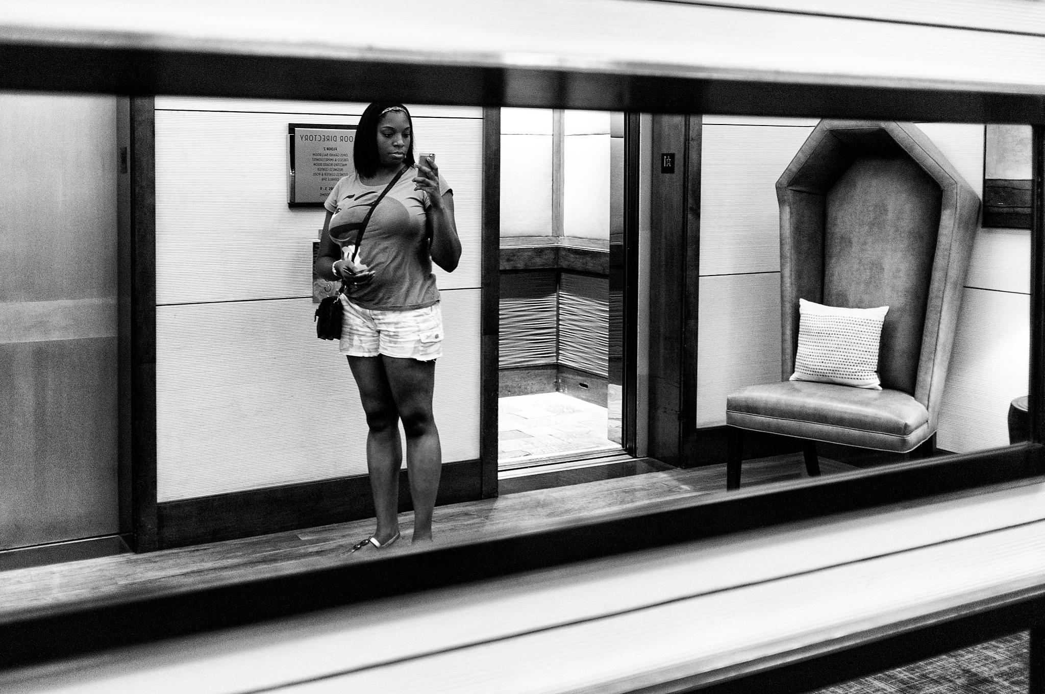 Photo in Street Photography #mirror #candid #street photography #black and white