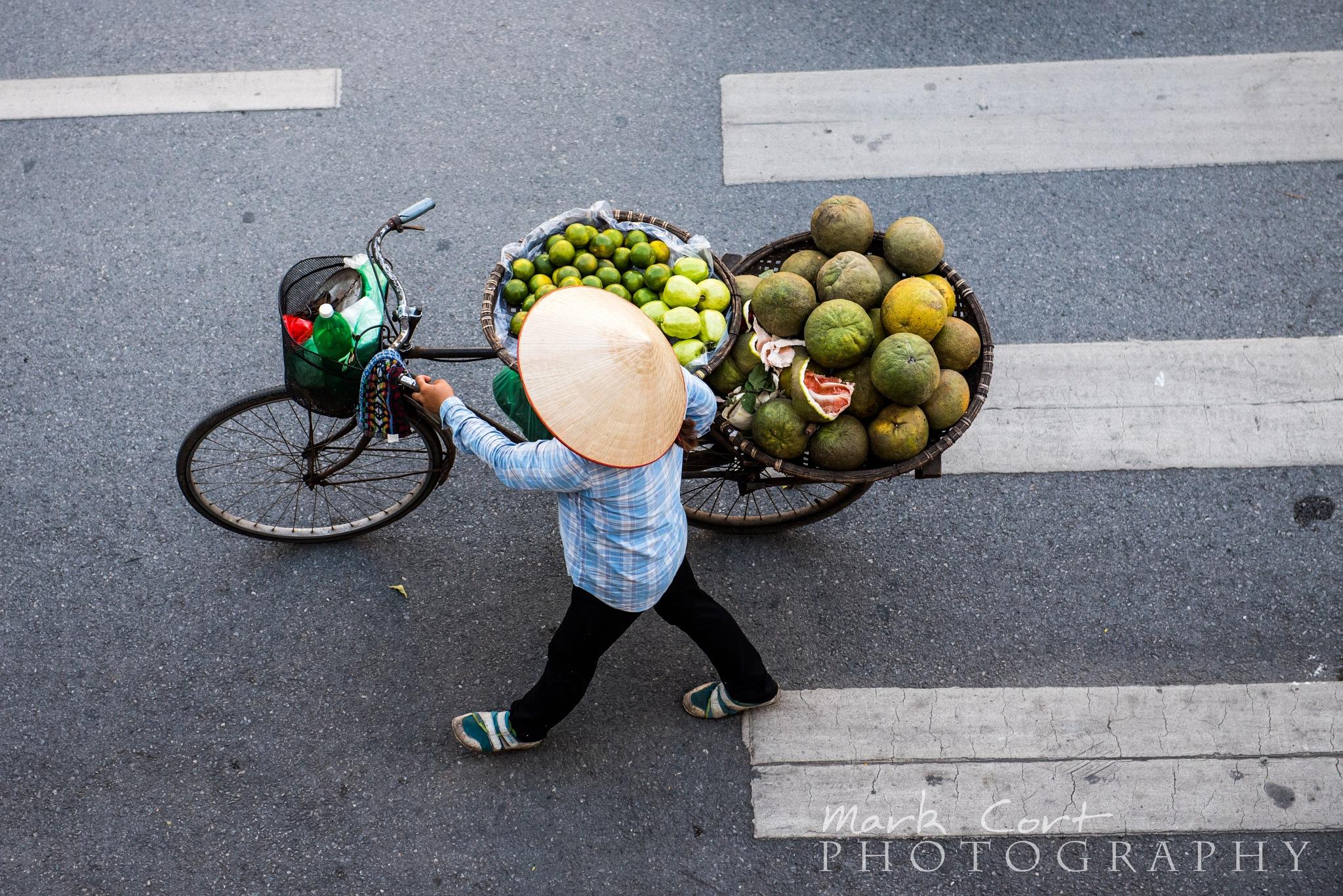 Street seller Hanoi by Mark Cort