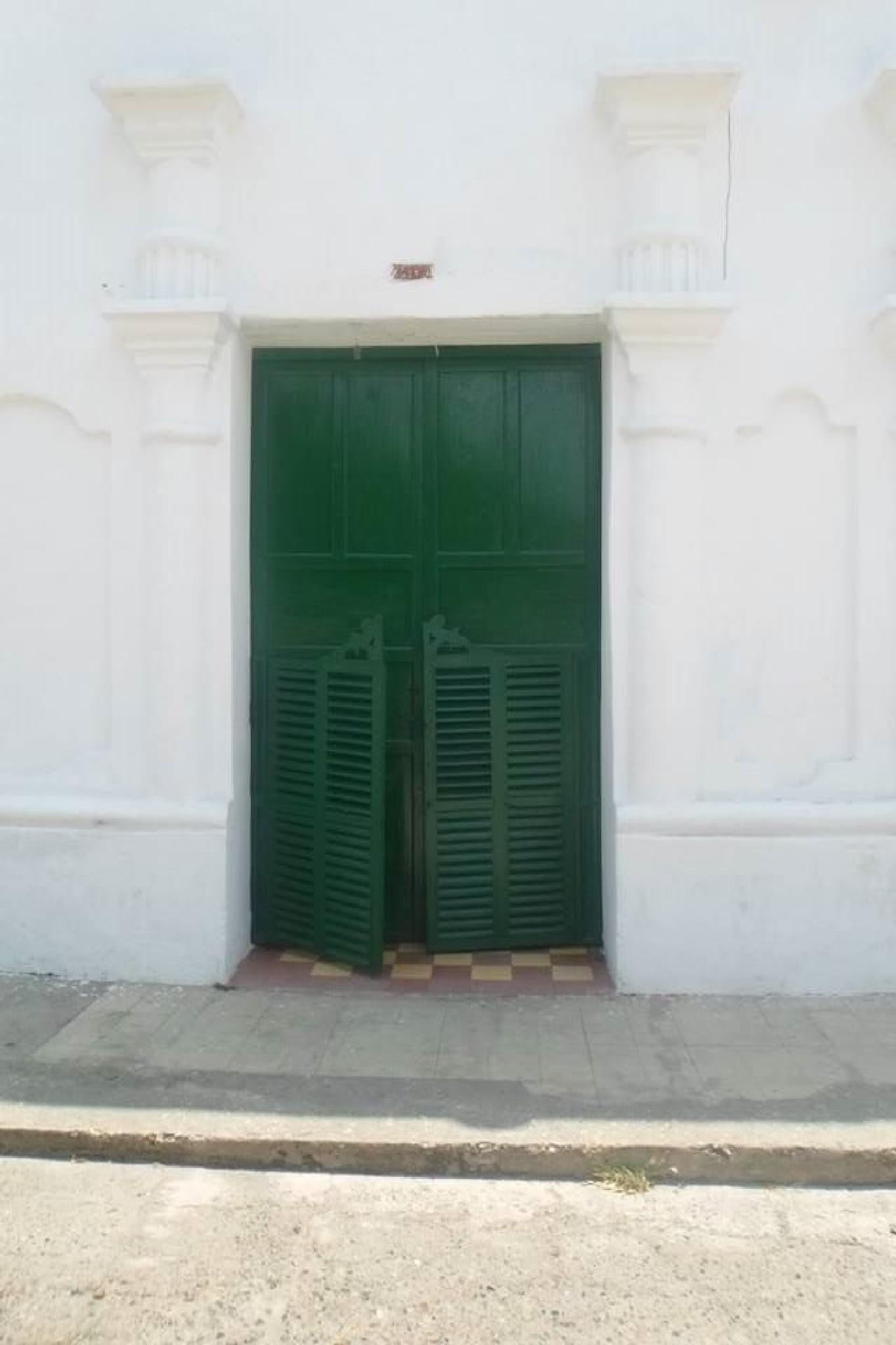 the green door in Corozal by castariza