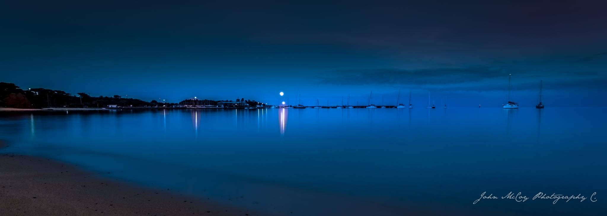 Moon set at sunset by johnmccoyphotography