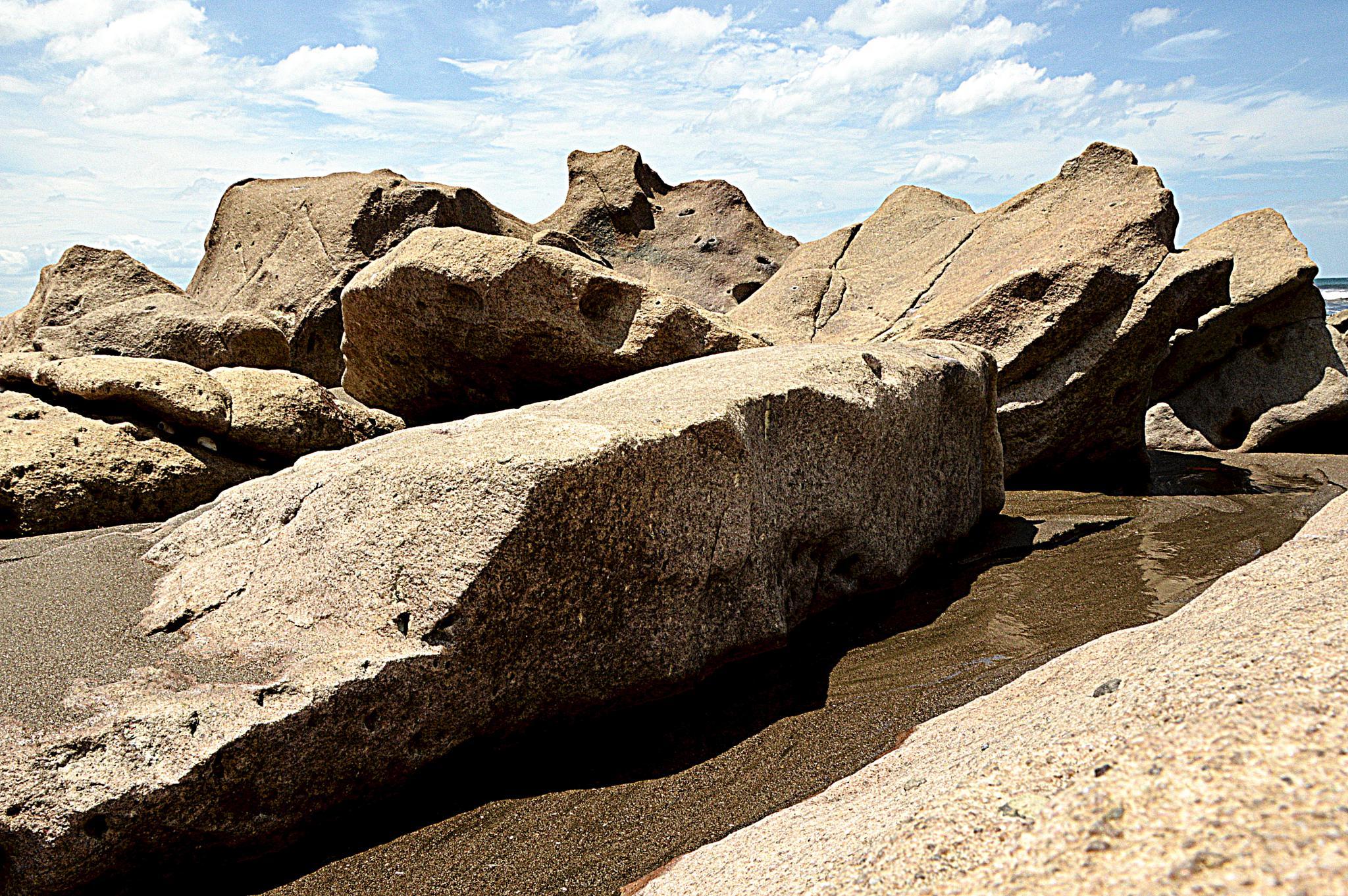 Seaside rocks by Ives Martinez