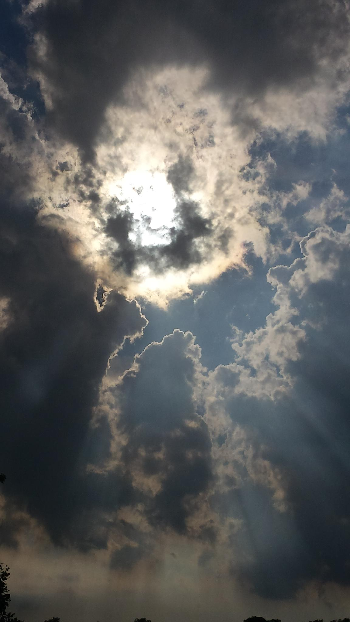 Photo in Landscape #sky #sun #shadows #faces #clouds