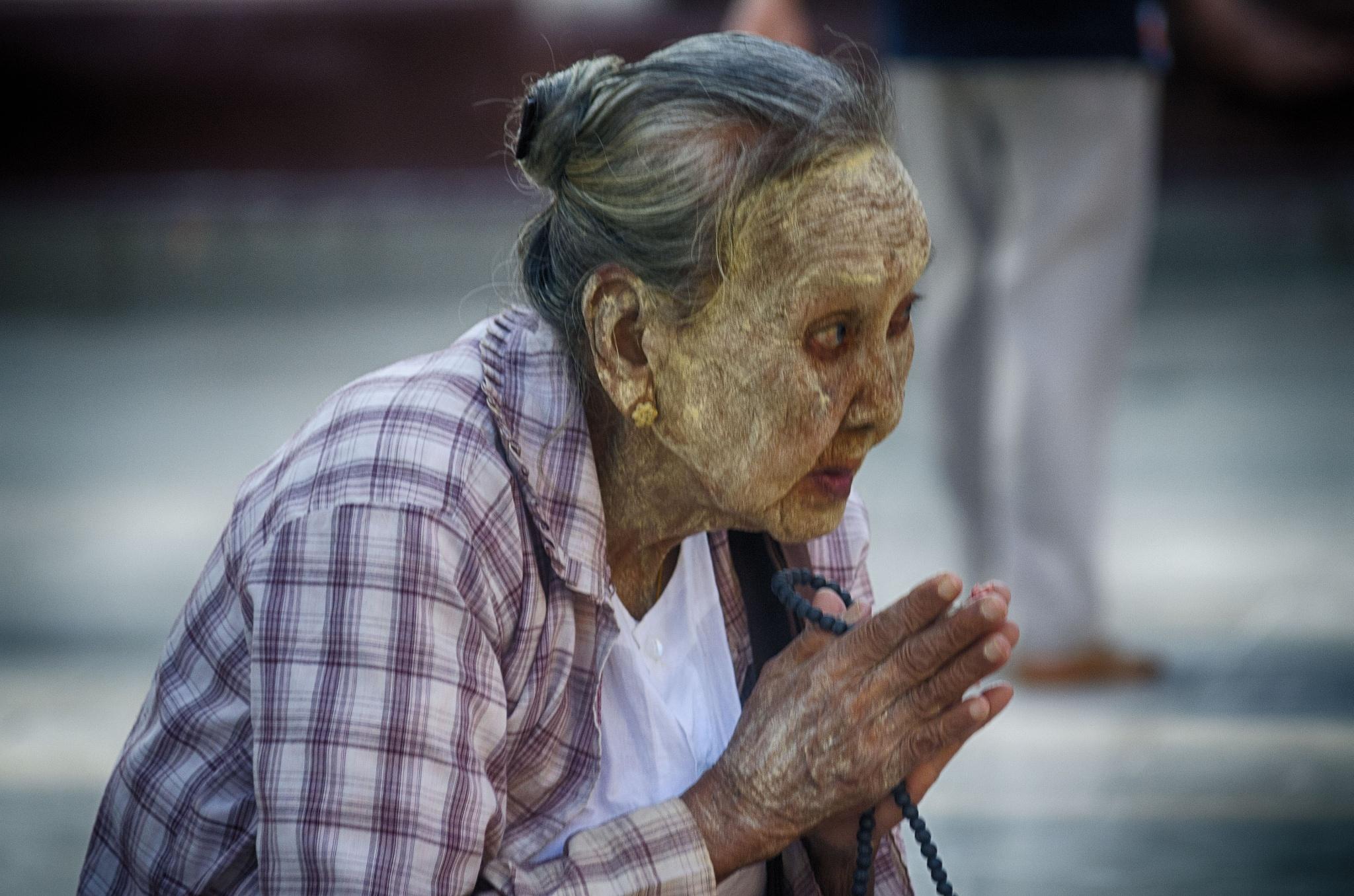 old woman praying at Shwenagon Pagoda, Yangon by jeece69