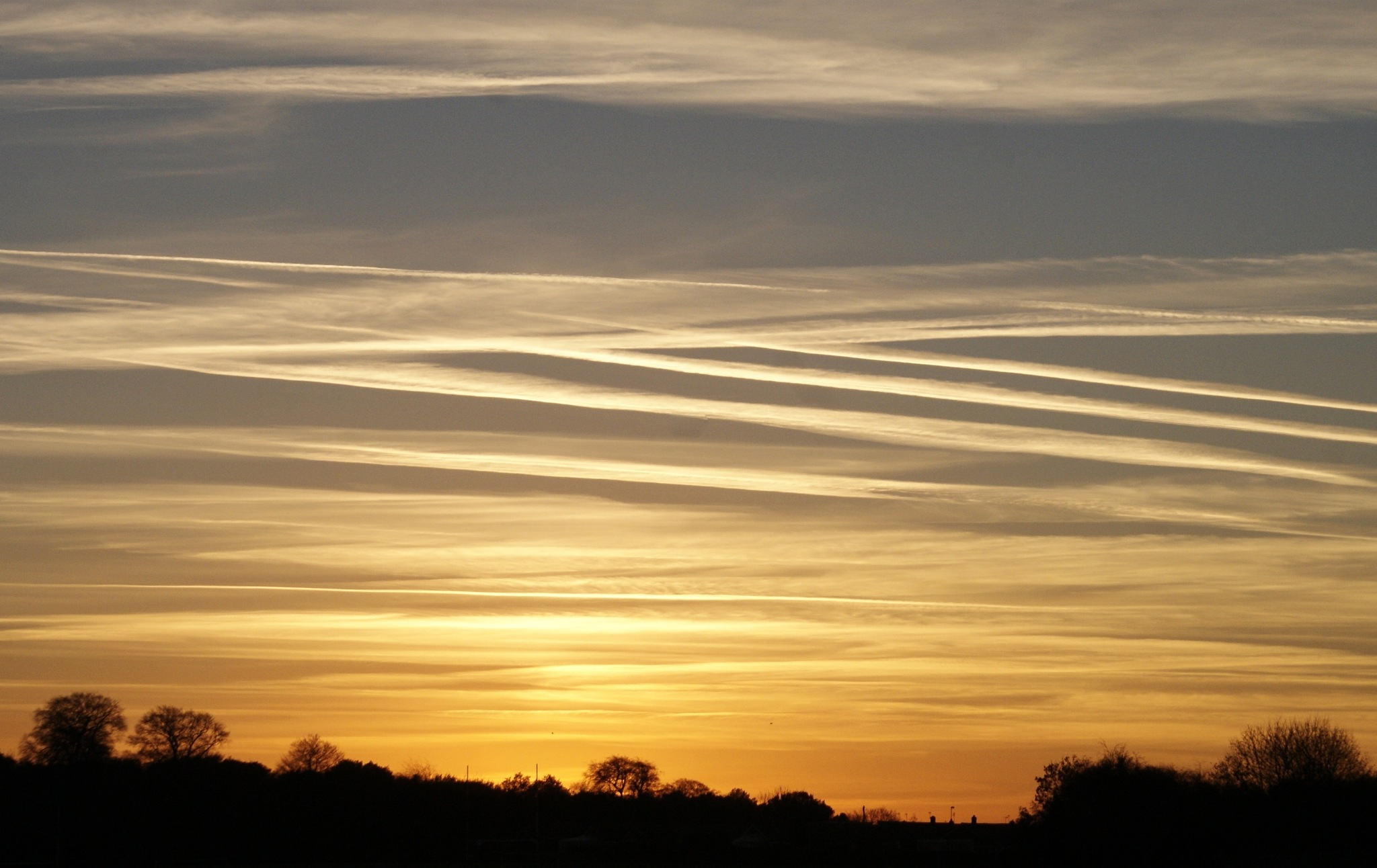 Sunset And Jet Trails by DenisJosephDalby